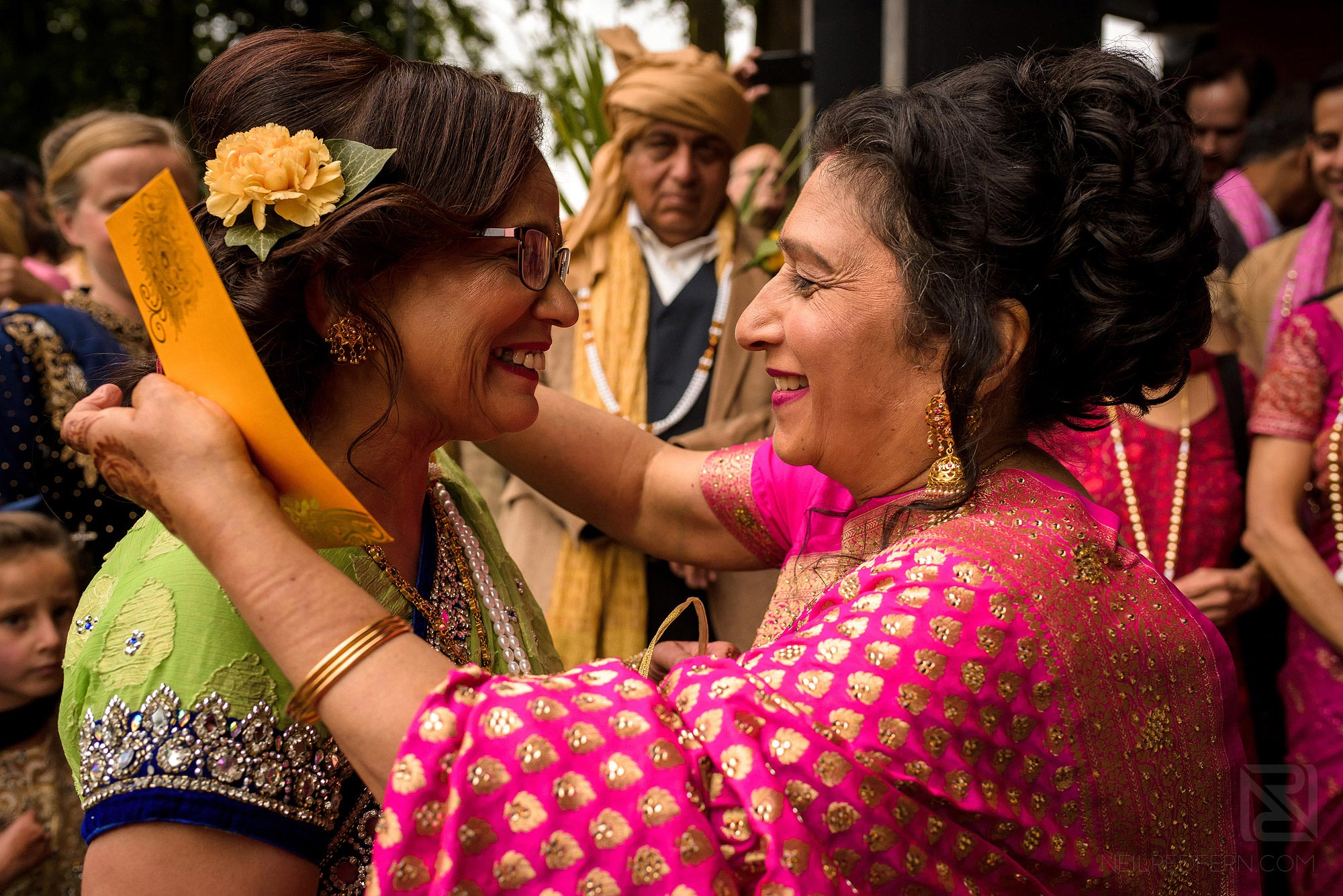 family members greeting each other before wedding ceremony