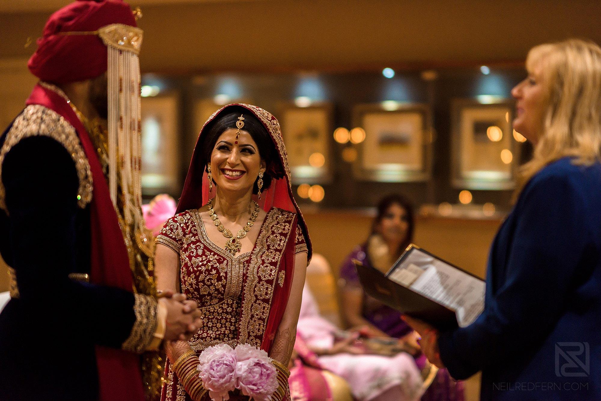 bride looking at groom during wedding ceremony