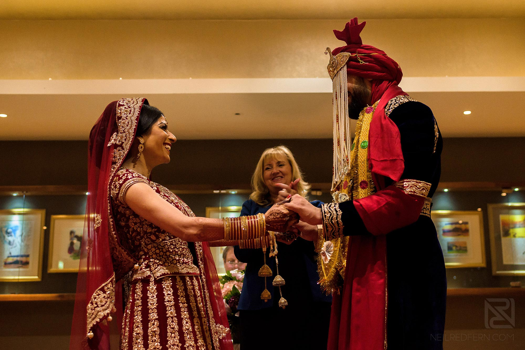 bride and groom smiling at each other during wedding ceremony