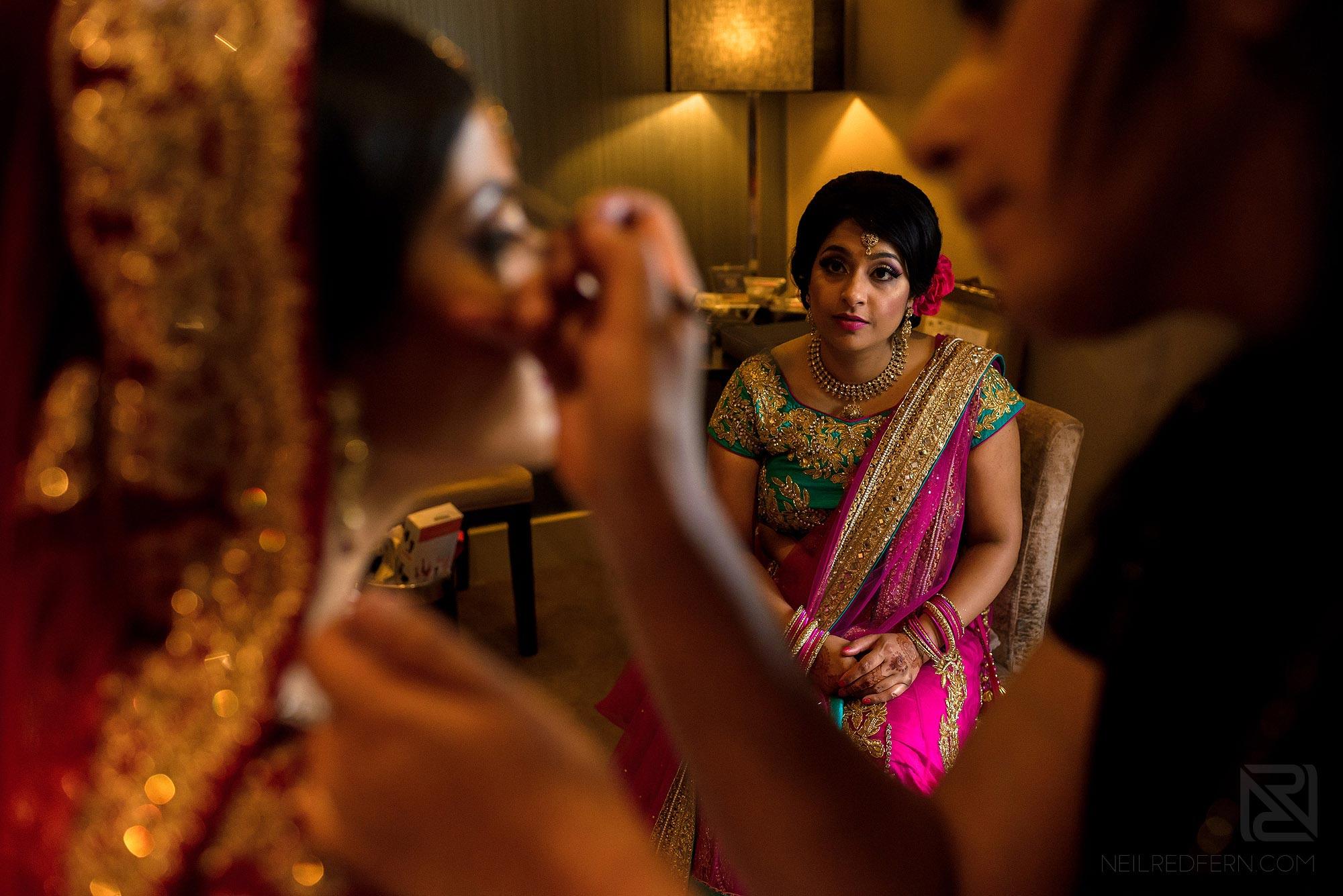 bridesmaid looking at bride