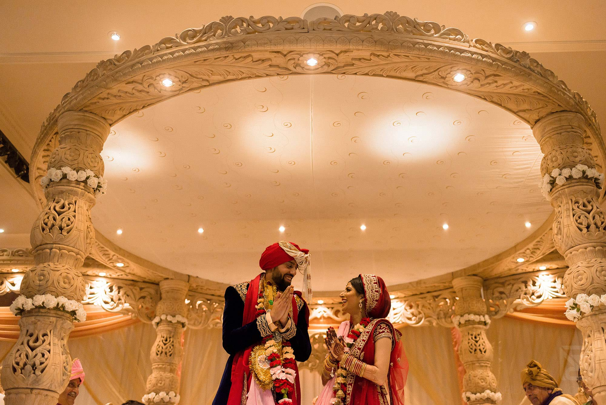 bride and groom looking at each other during Indian wedding