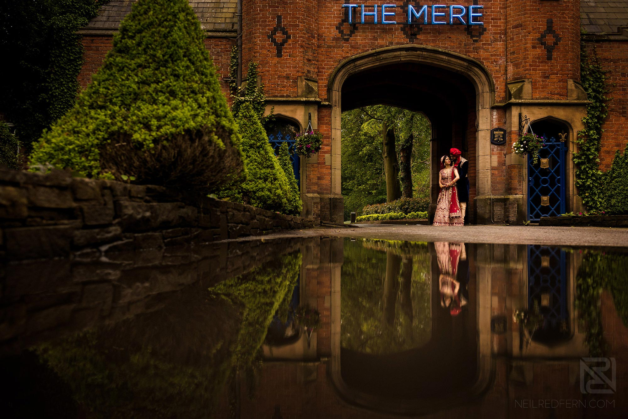 creative photograph of Indian bride and groom