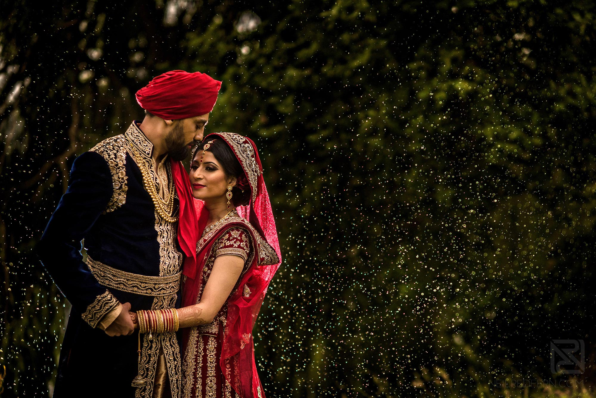 stunning photograph of Indian bride and groom in the rain