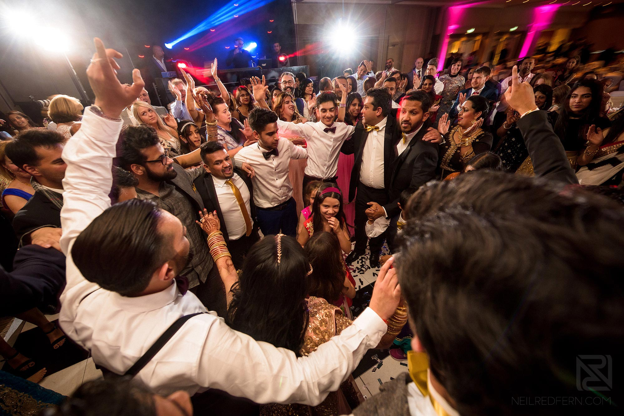 guests dancing during Indian wedding reception in Manchester