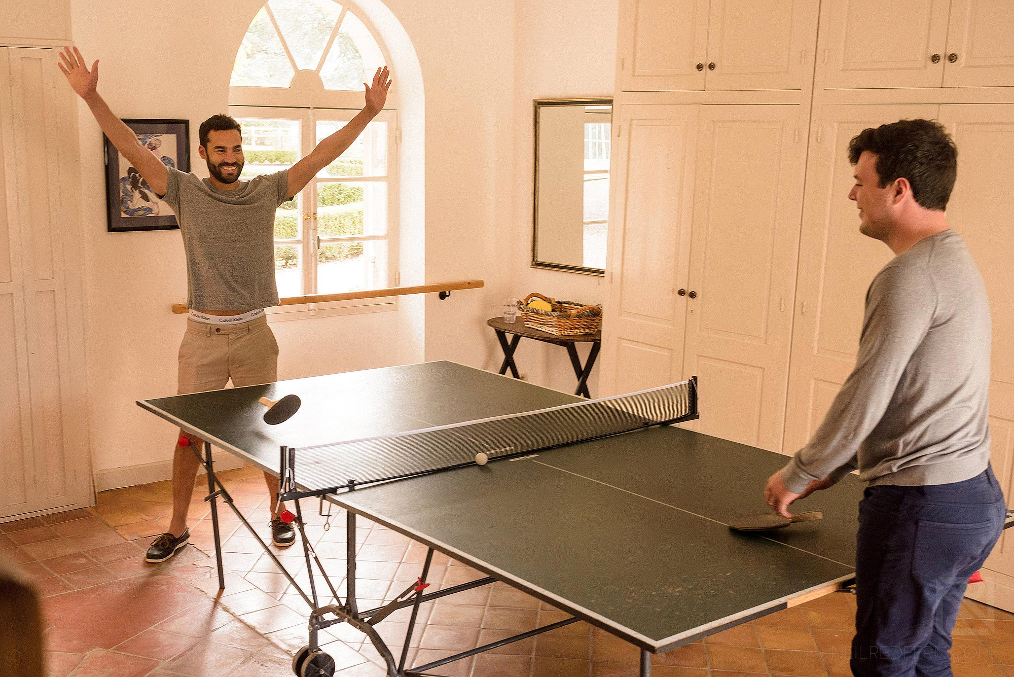 groom and best man playing table tennis