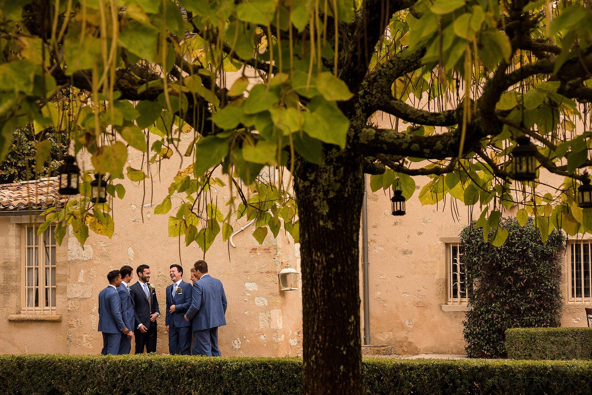 groomsmen laughing before wedding ceremony