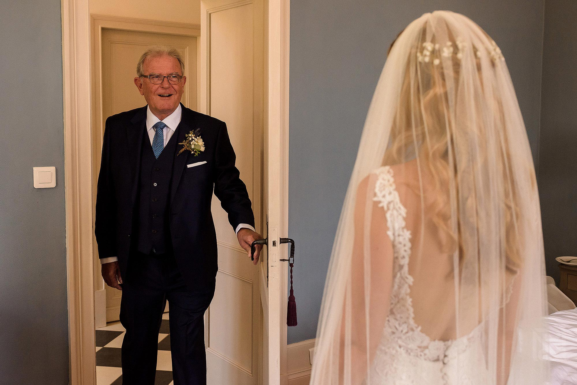 father of bride seeing daughter in dress for first time