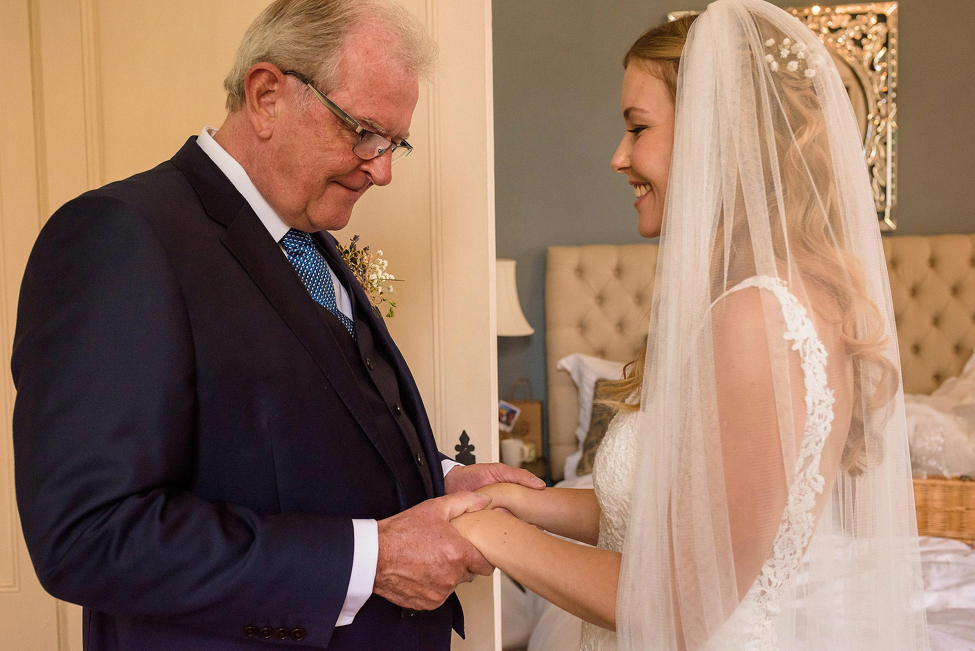 emotional moment between dad and bride before wedding