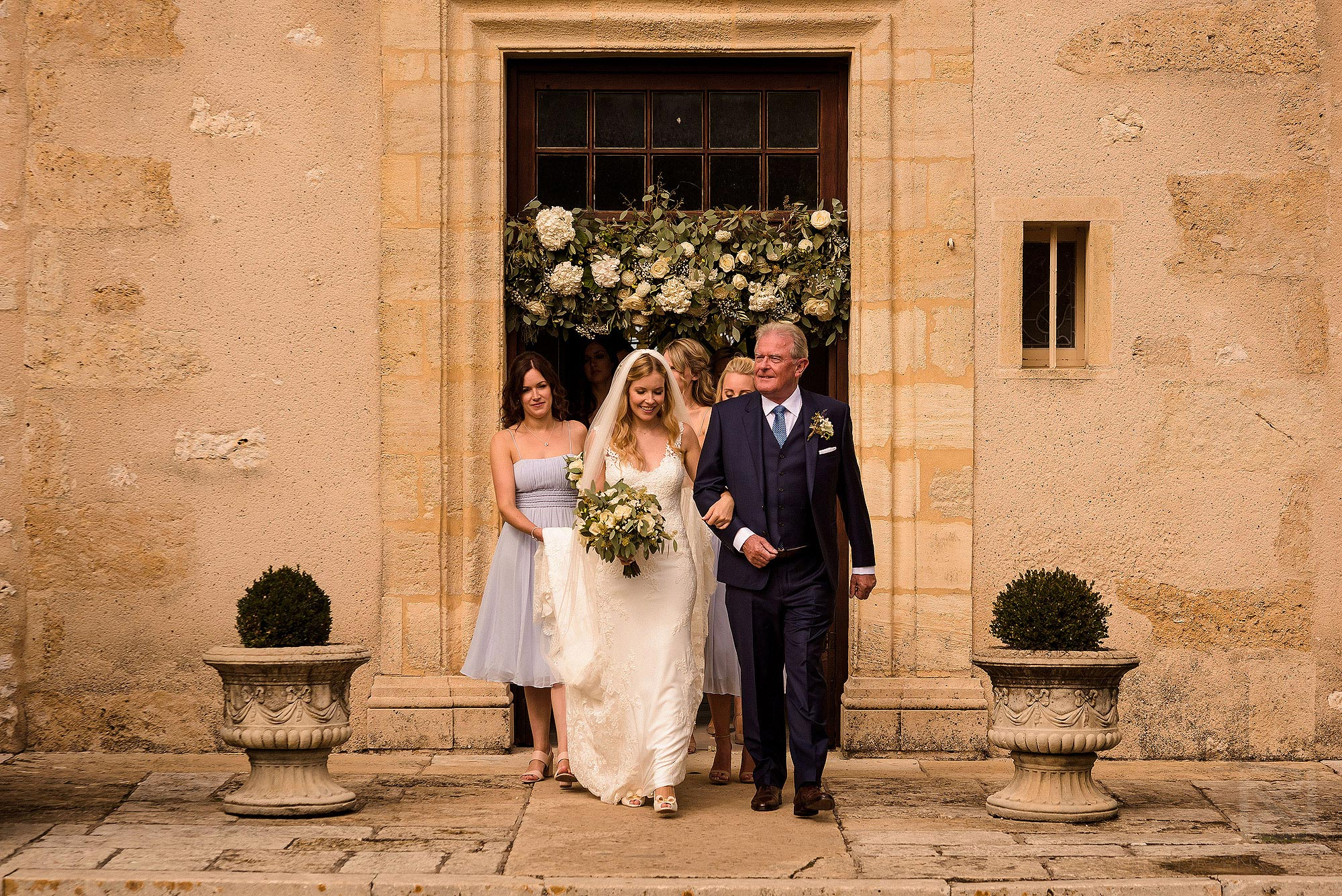 bridal party walking to wedding ceremony at Chateau Soulac in France