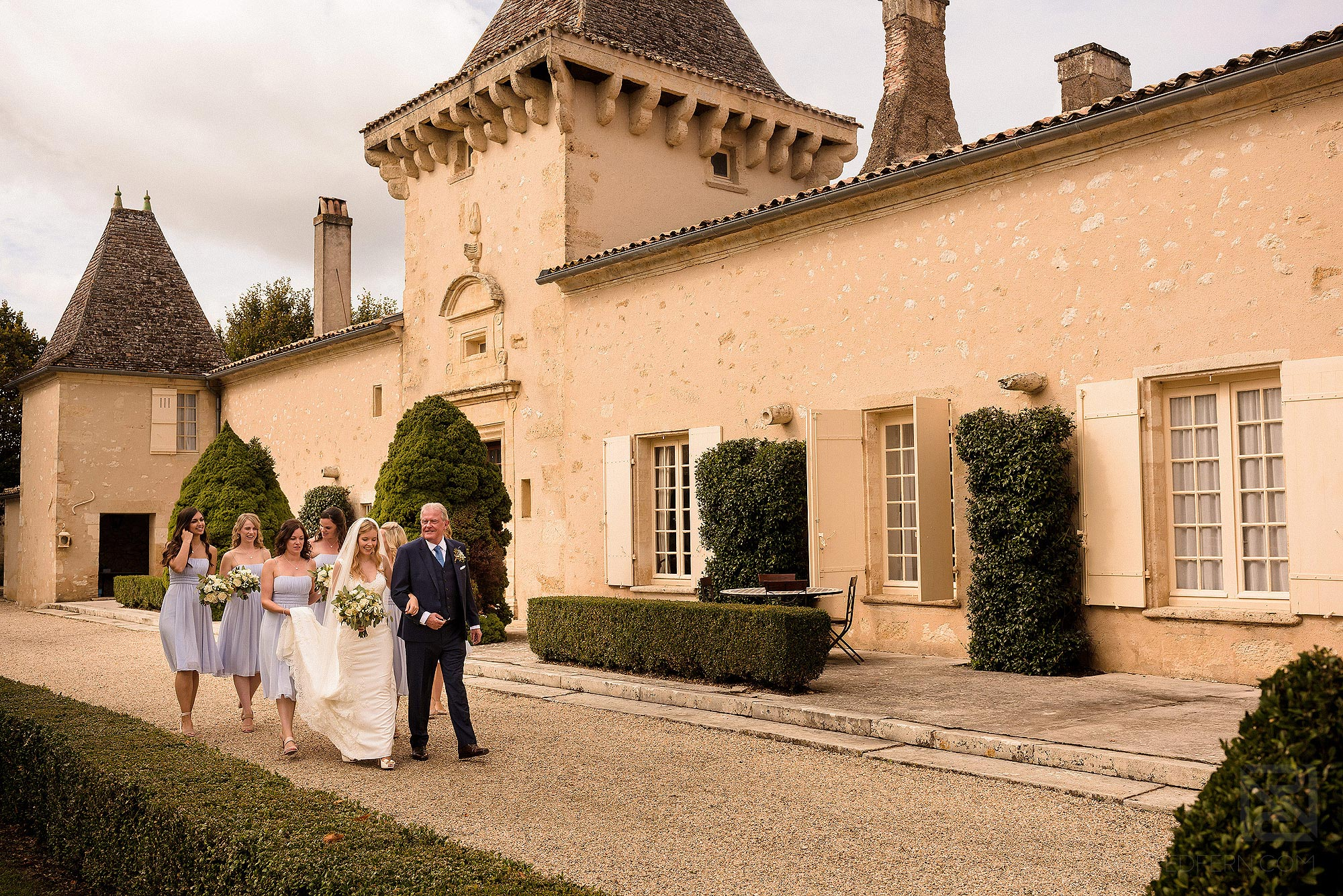 bridal party walking through Chateau Soulac grounds on way to ceremony