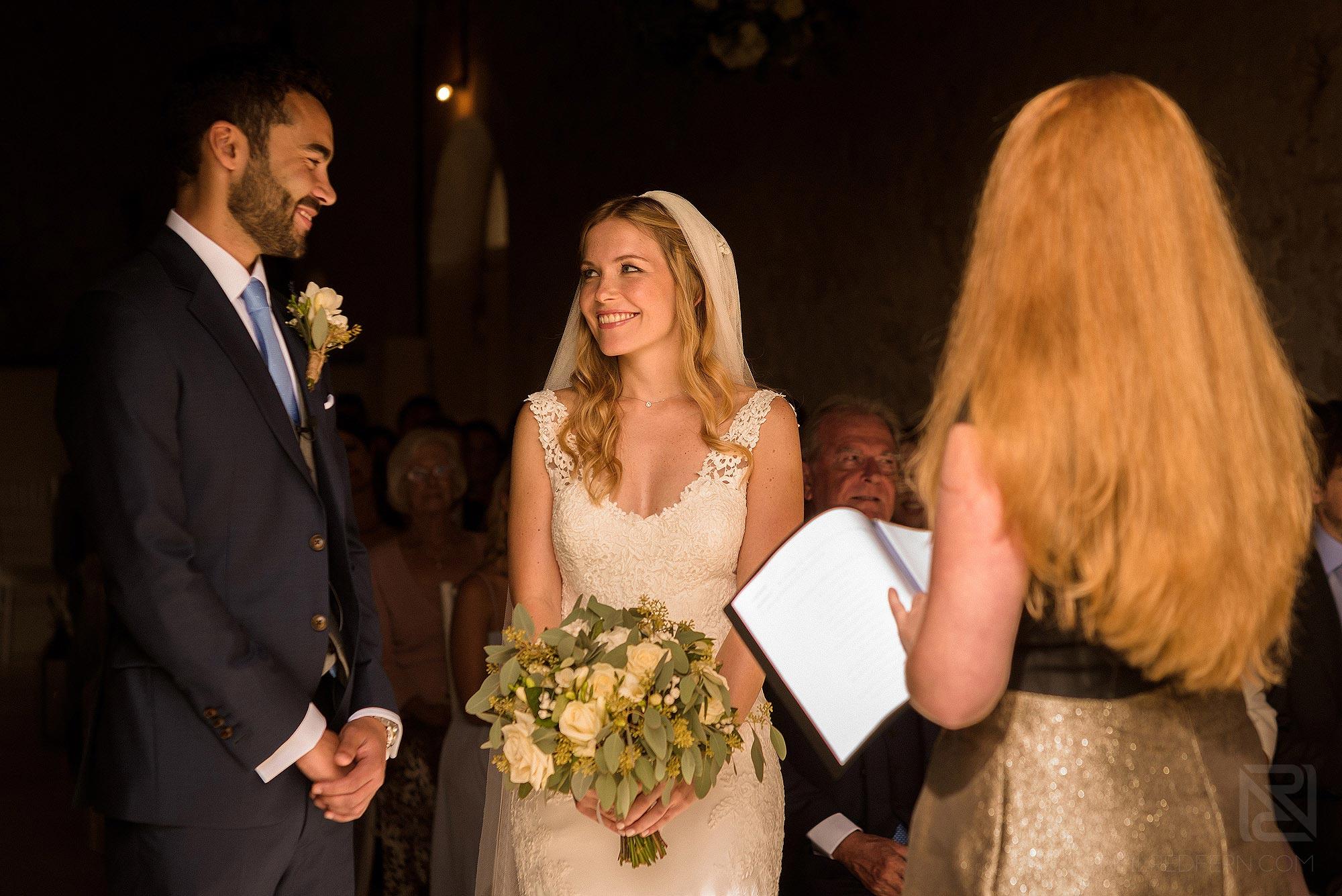 happy moment between bride and groom during wedding ceremony