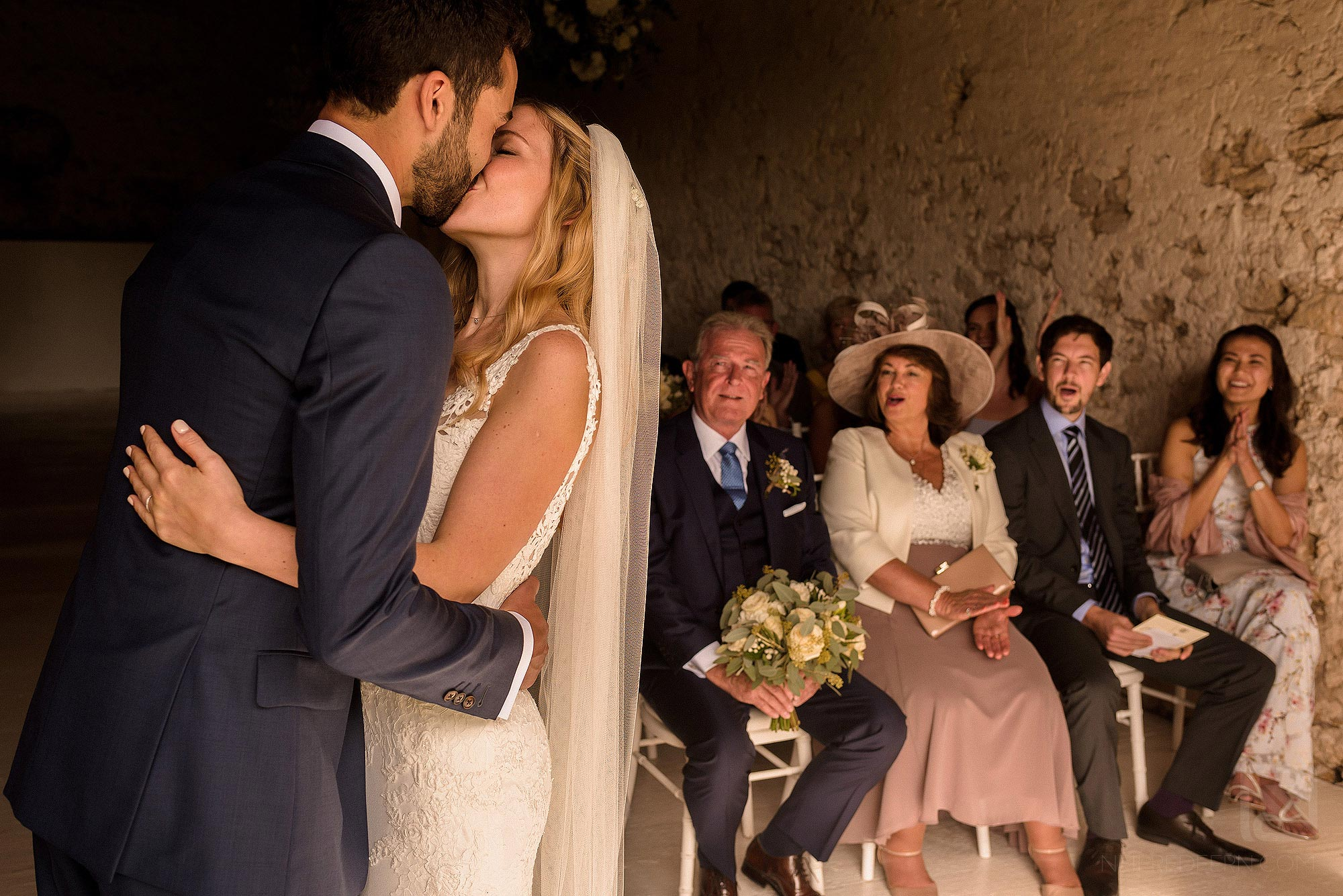 first kiss during wedding at Chateau Soulac