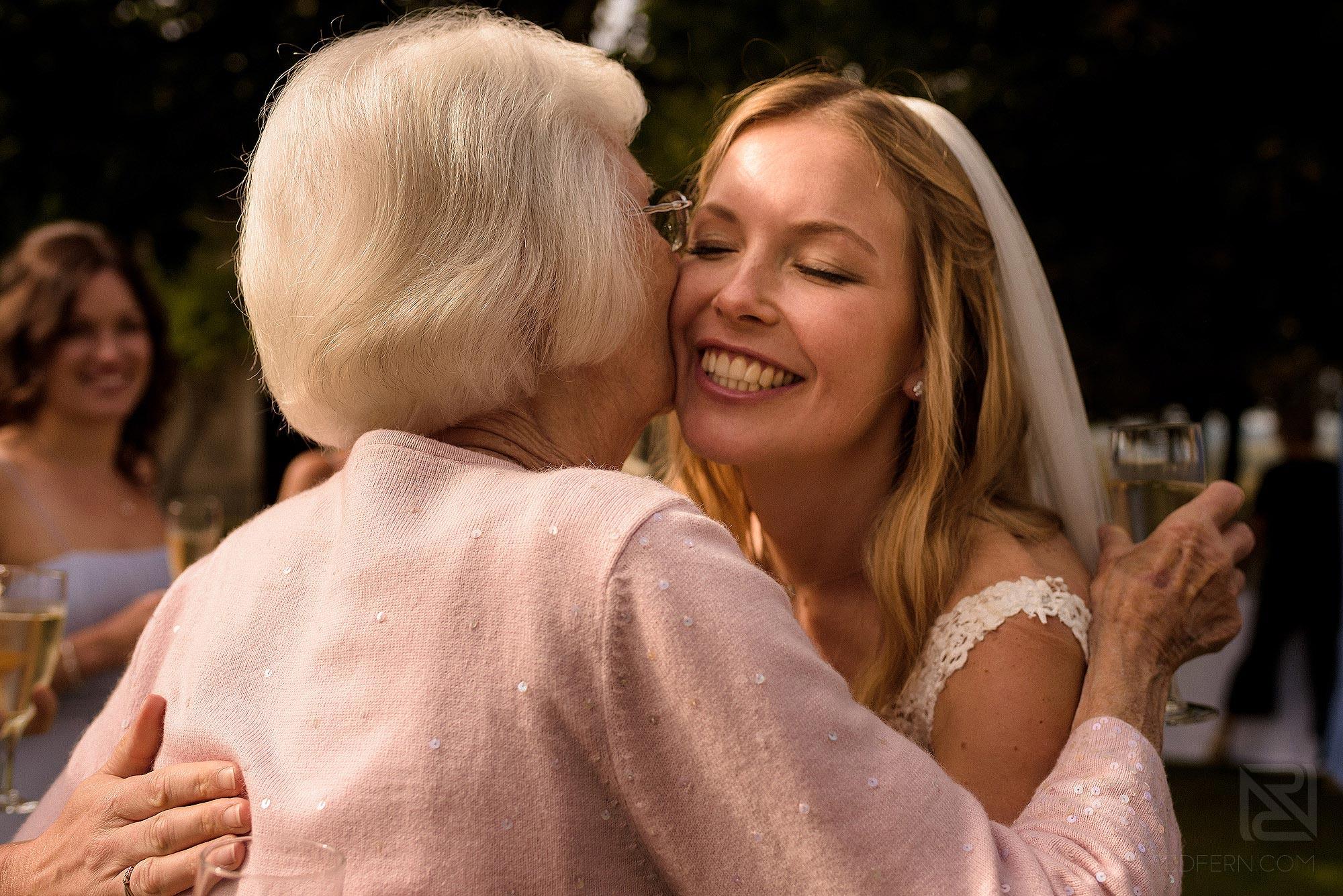 grandmother hugging bride