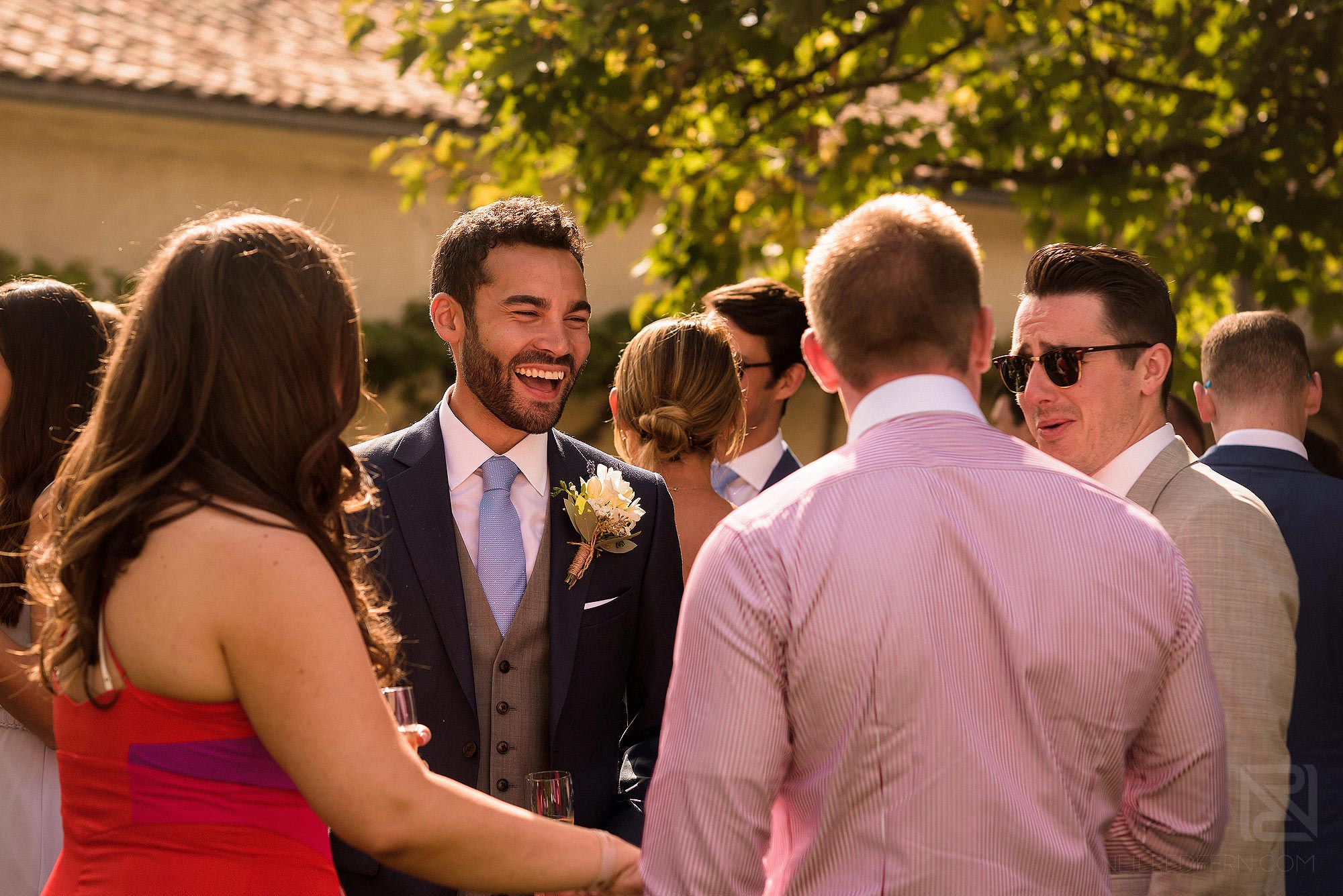 groom laughing during drinks reception