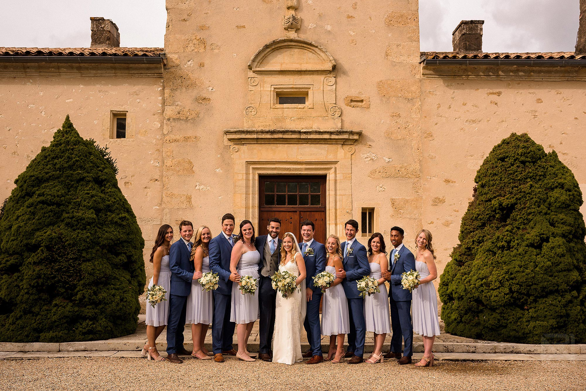 portrait of bridal party together at Chateau Soulac