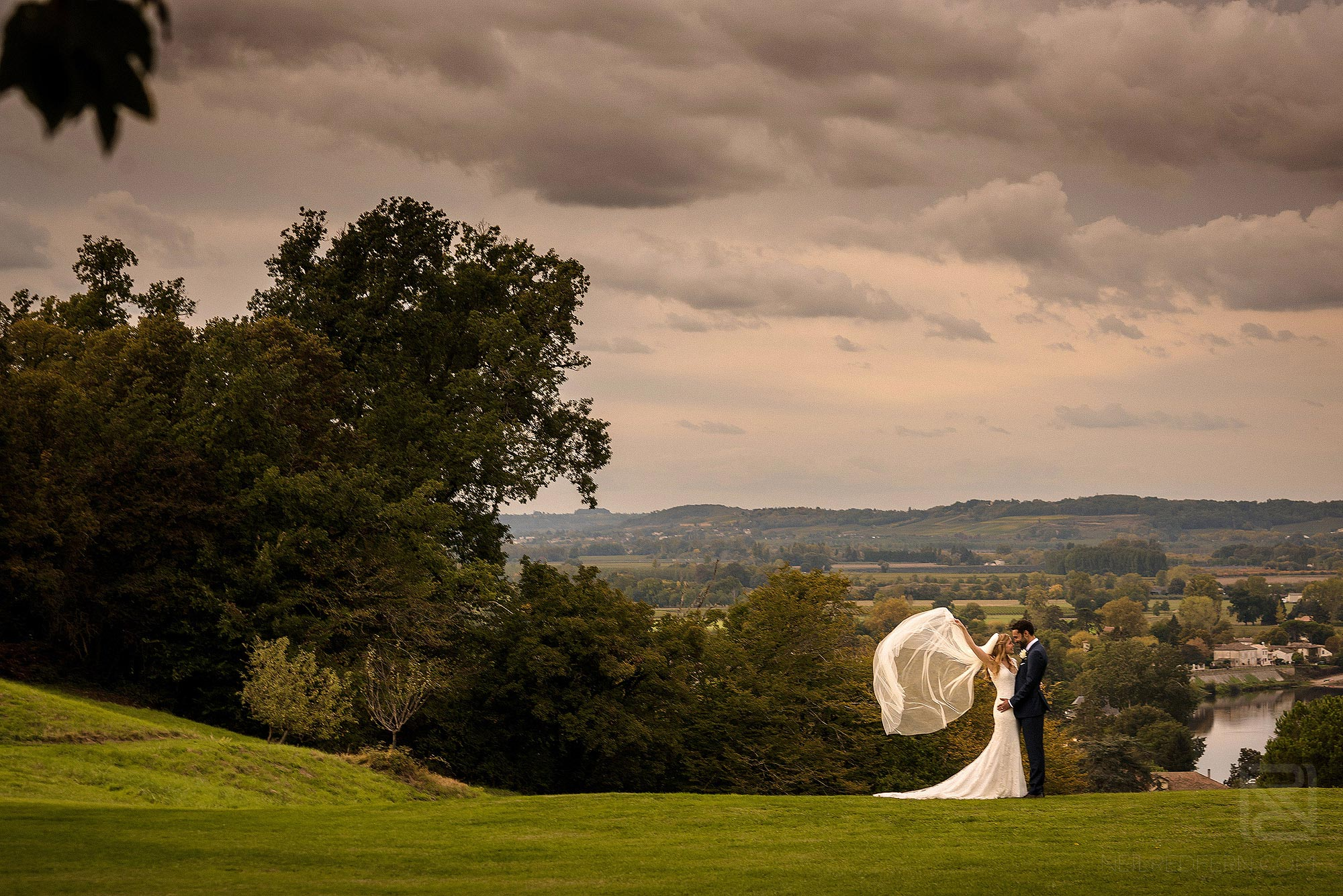 bride's veil blowing in the wind at Chateau Soulac