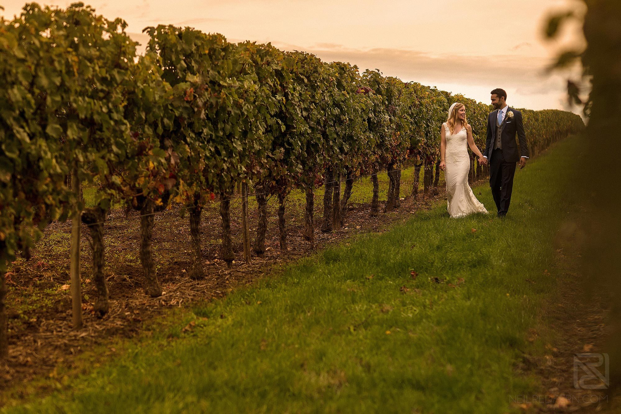 bride and groom walking together outside Chateau Soulac