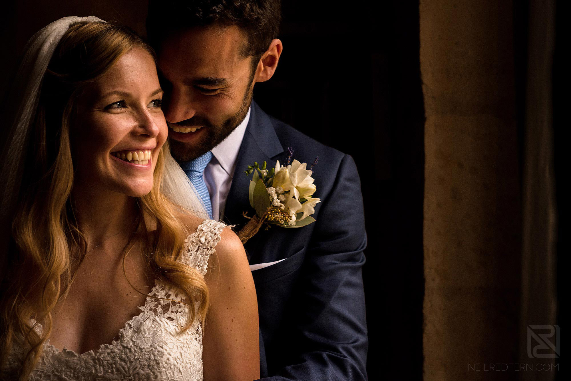 intimate portrait of bride and groom inside Chateau Soulac