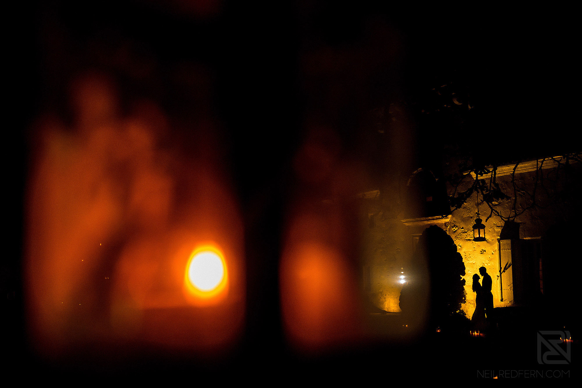 silhouette photograph of bride and groom at night