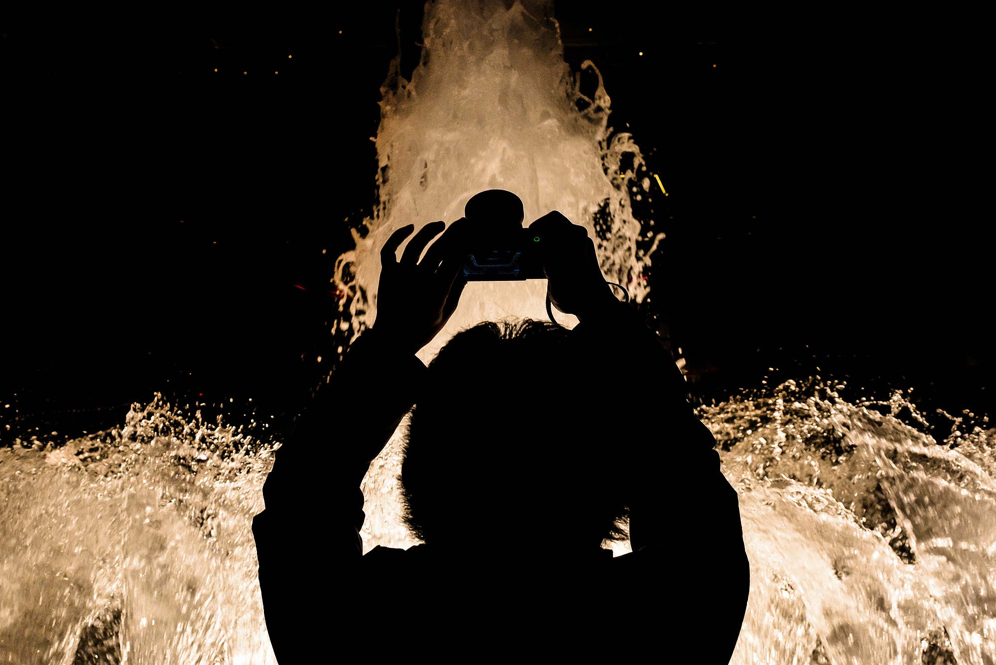 creative silhouette photograph of woman with camera