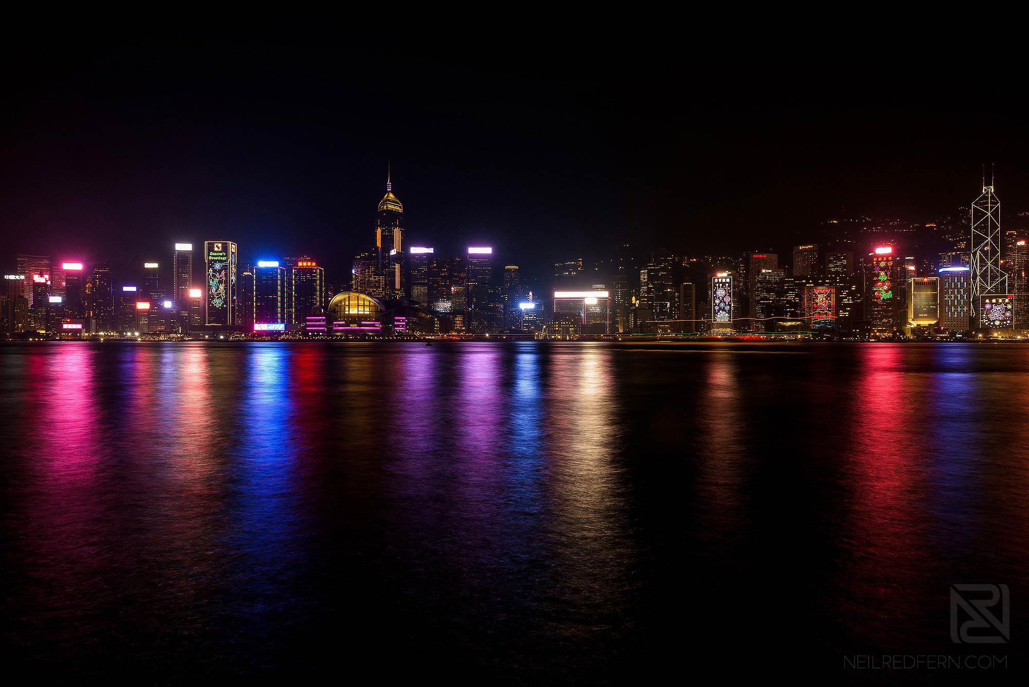 long exposure photograph of Victoria Harbour at night