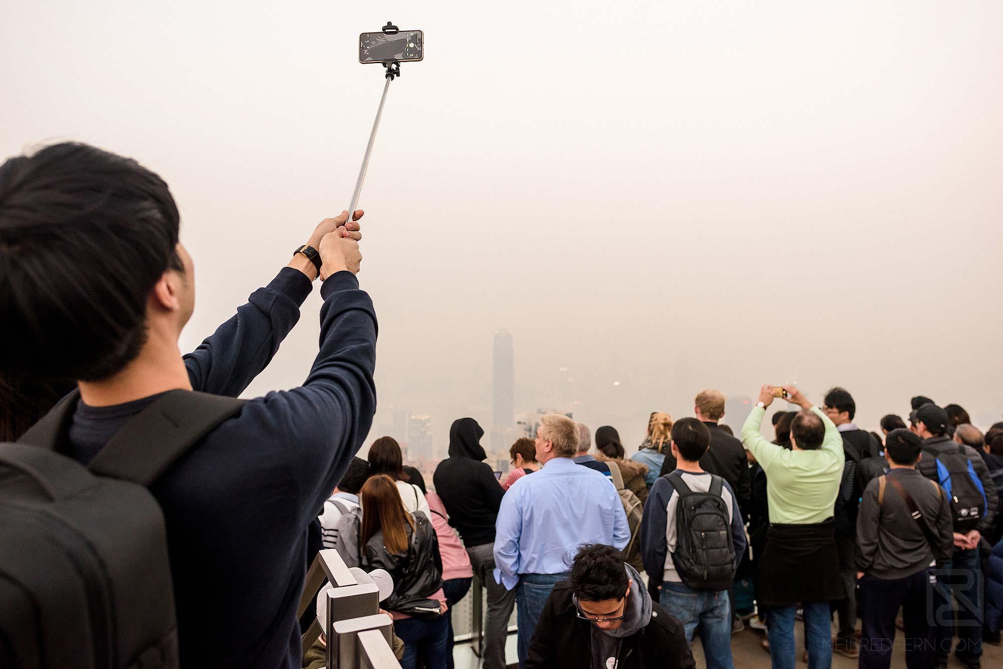 tourists taking photographs at Victoria Peak