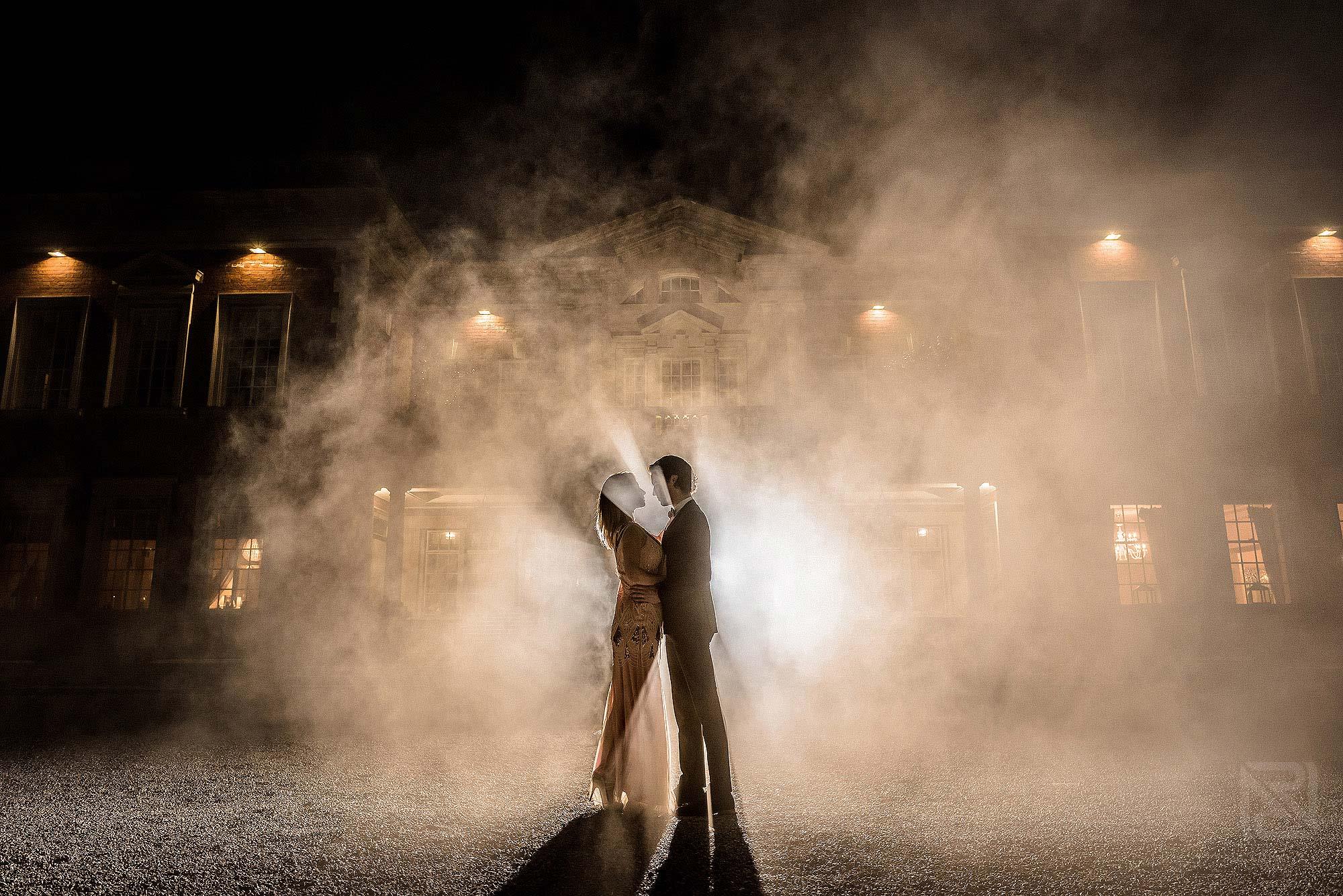 photograph of bride and groom using smoke bomb