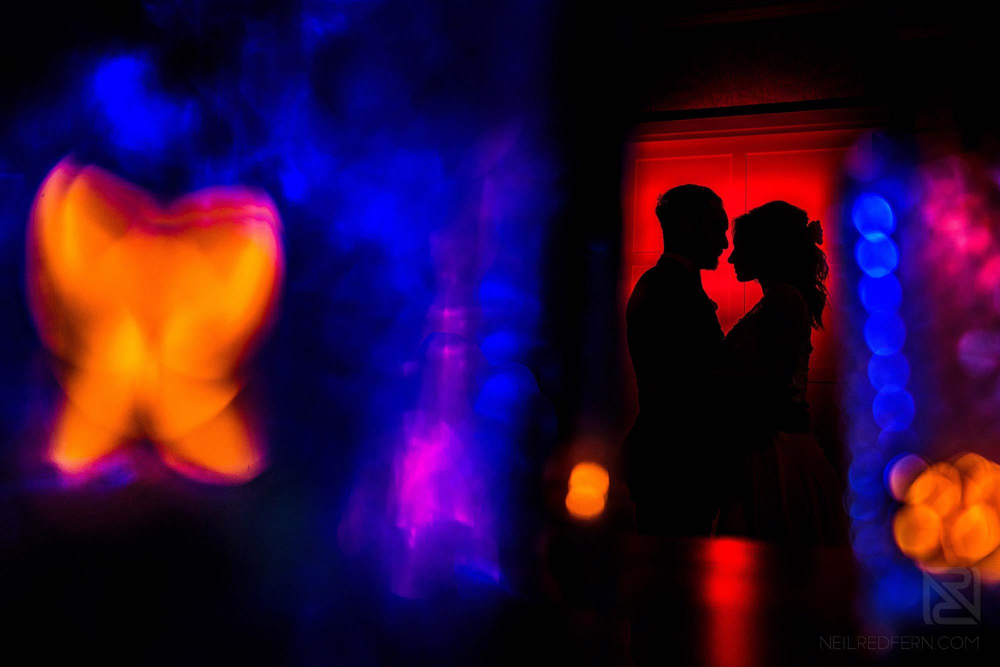 creative flash portrait of newlyweds