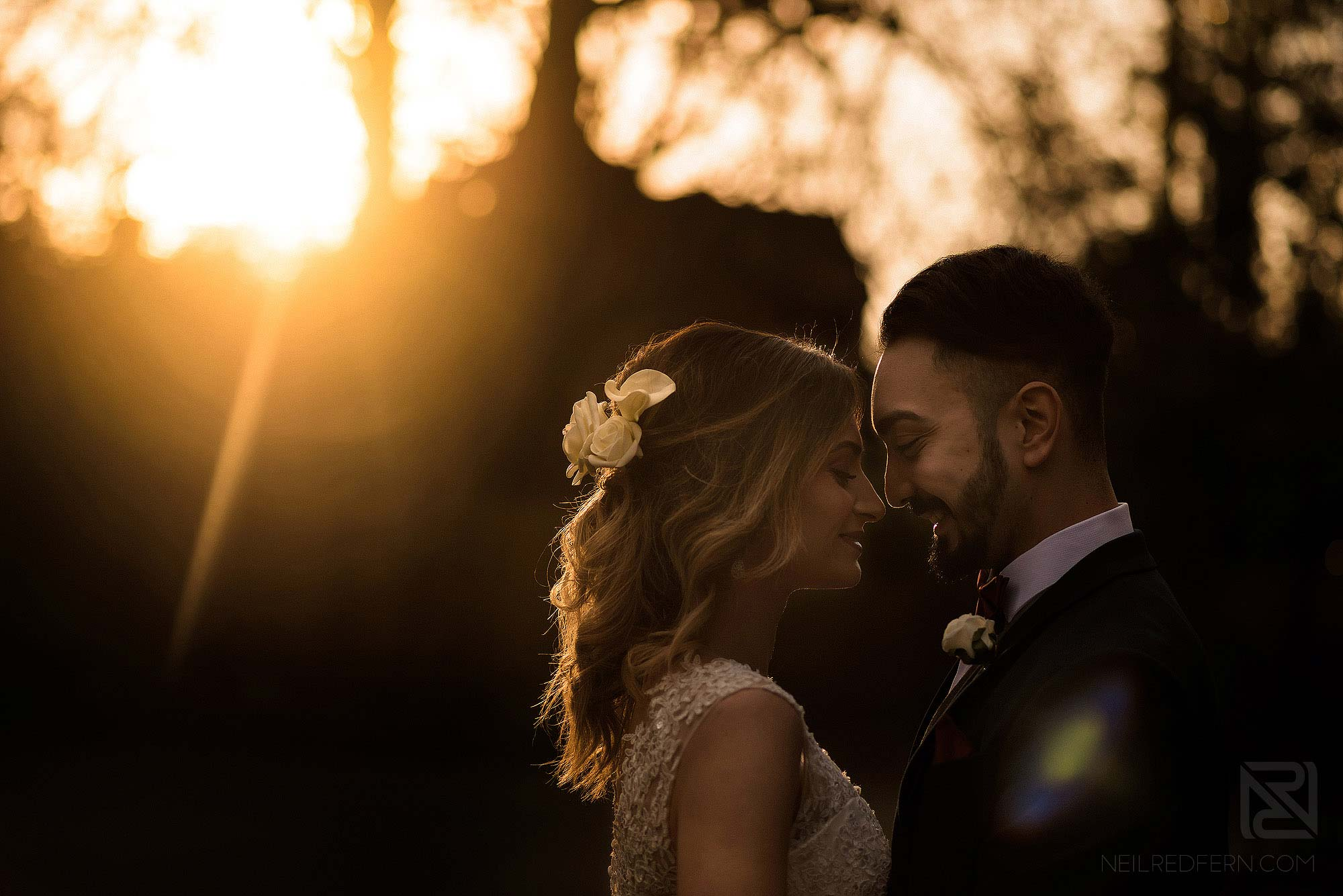 photograph of bride and groom taken at sunset