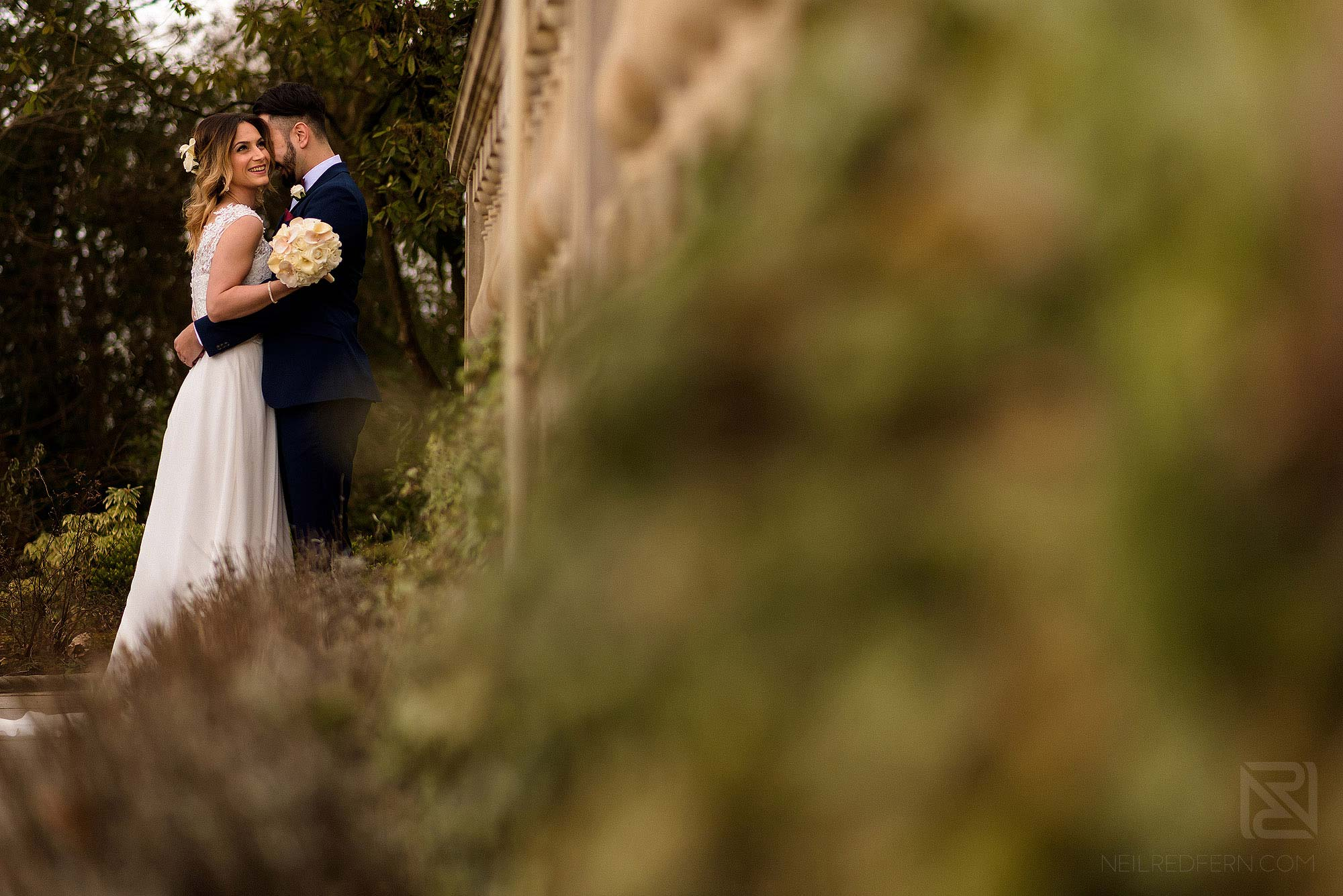 happy photo of bride and groom laughing on wedding photography workshop