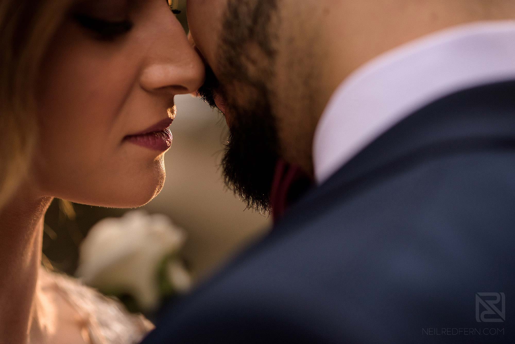 close up photograph of bride and groom about to kiss