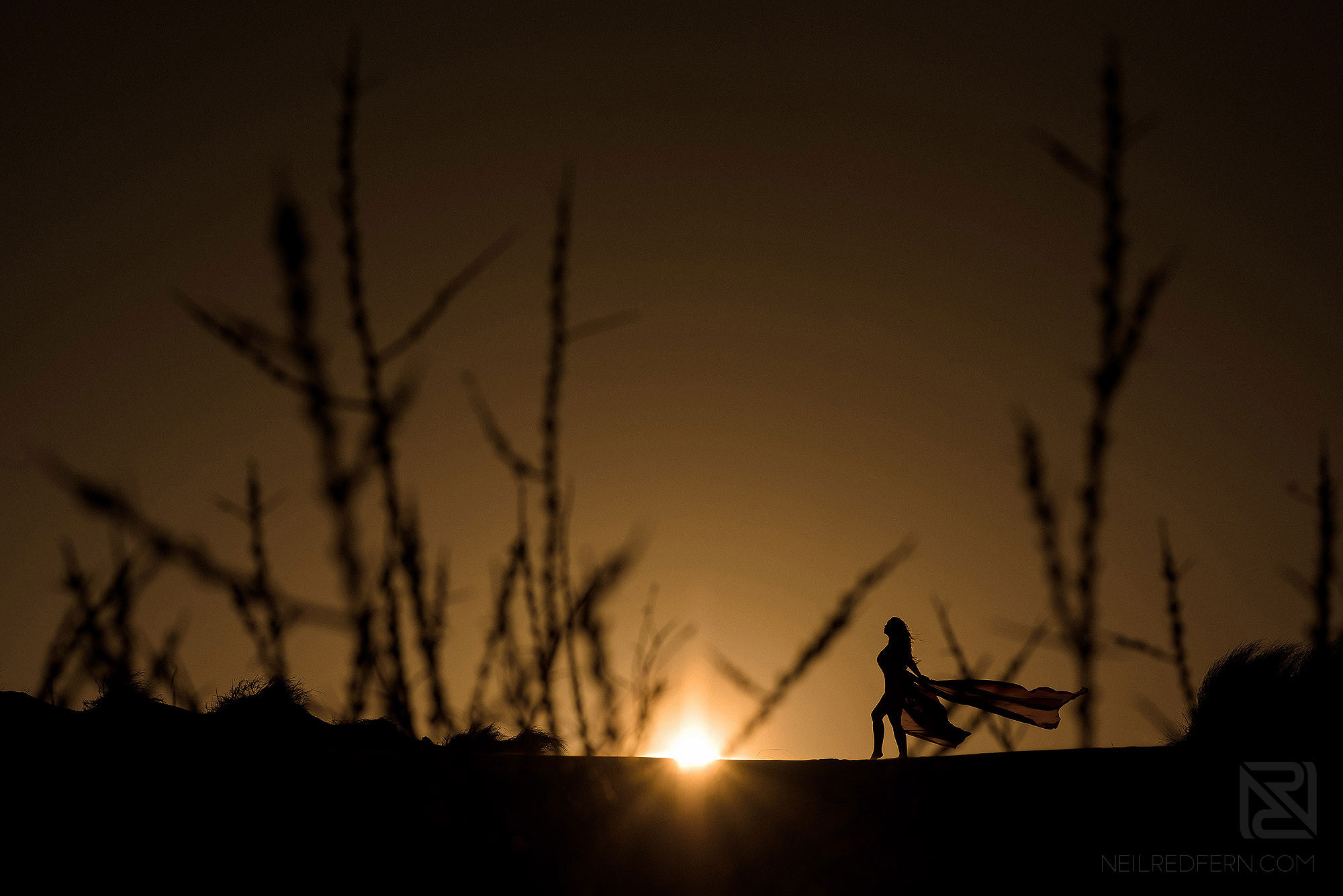 silhouette photograph of bride in dunes at Fromby