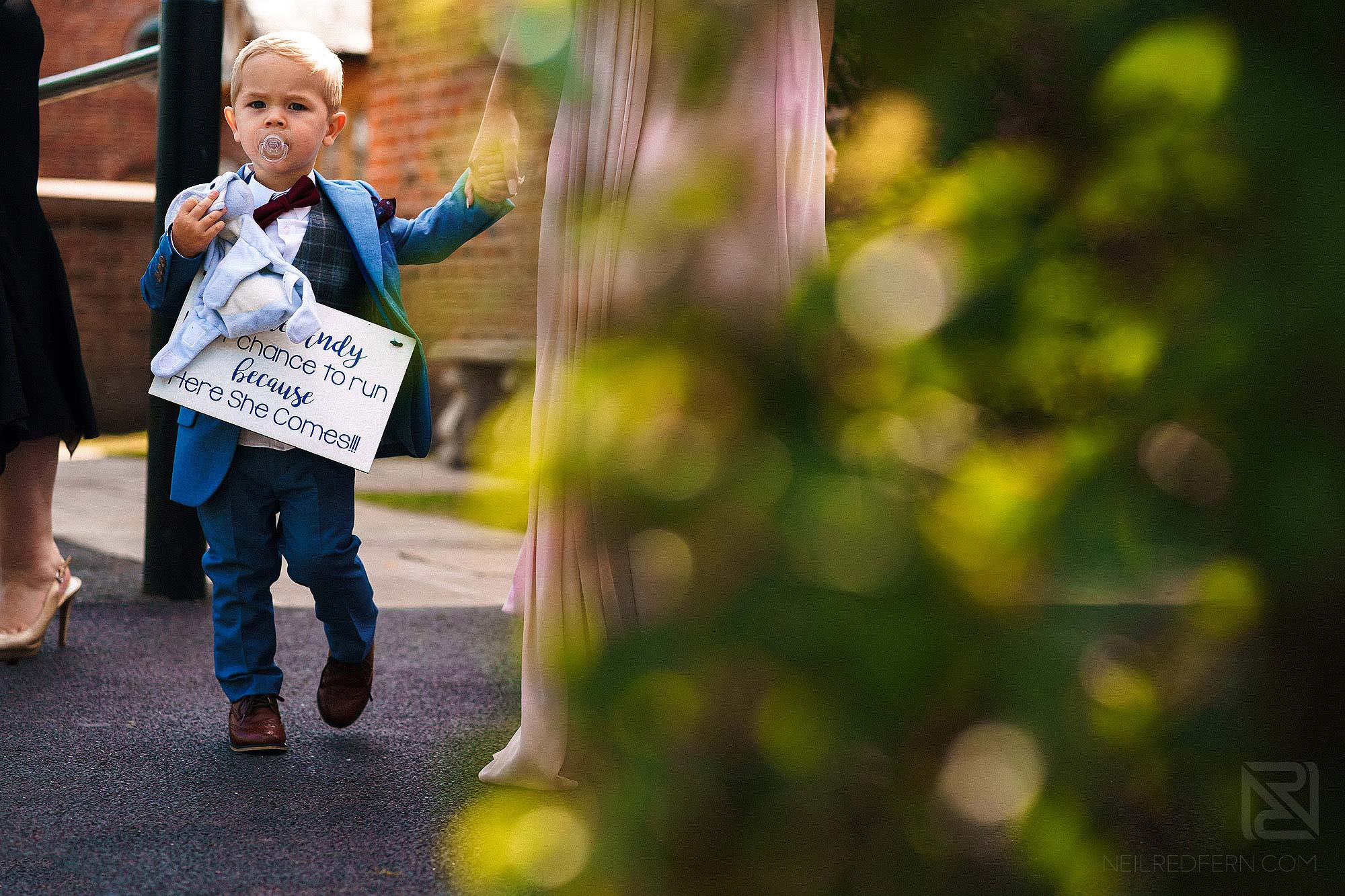page boy carrying sign