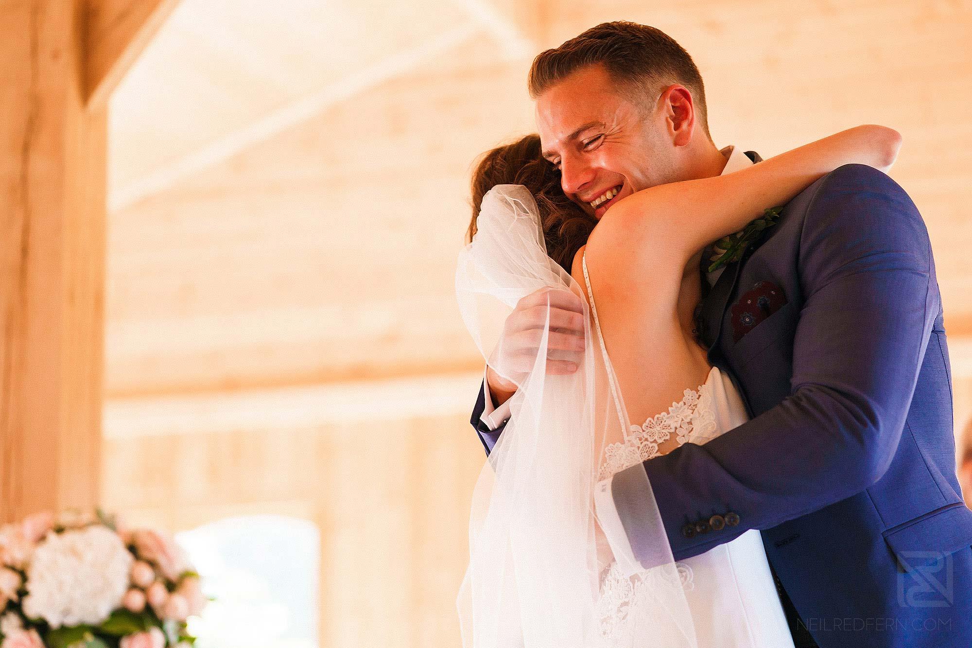 bride and groom hugging during weddingat Merrydale Manor