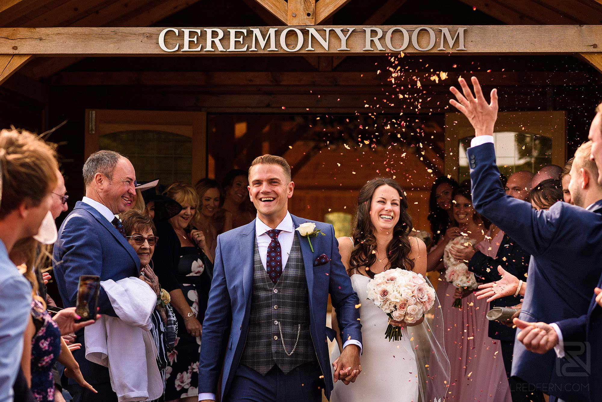 guests throwing confetti at Merrydale Manor wedding