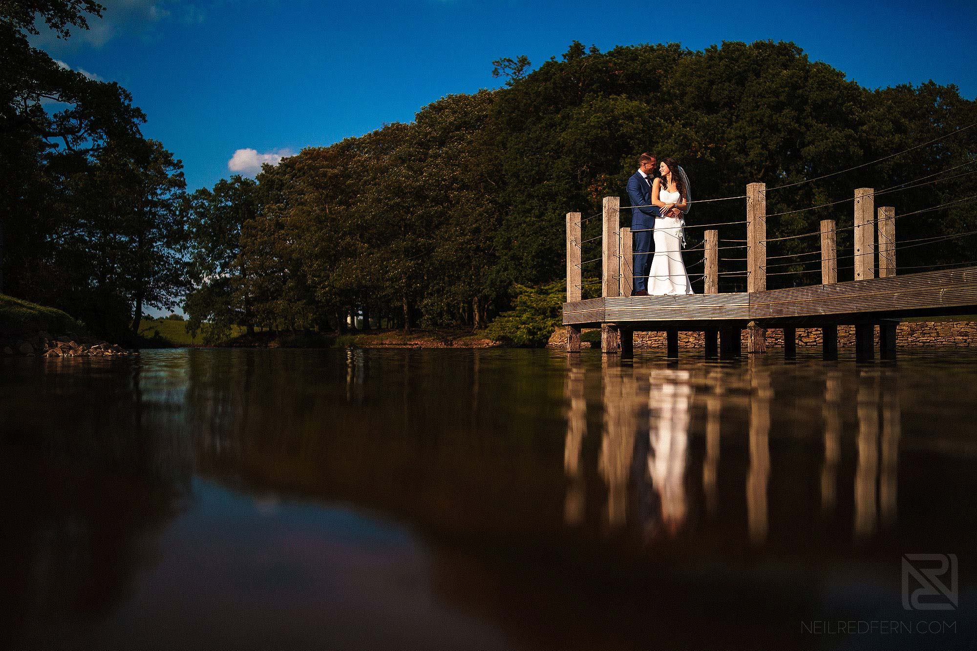 bride and groom on jetty at Merrydale Manor wedding