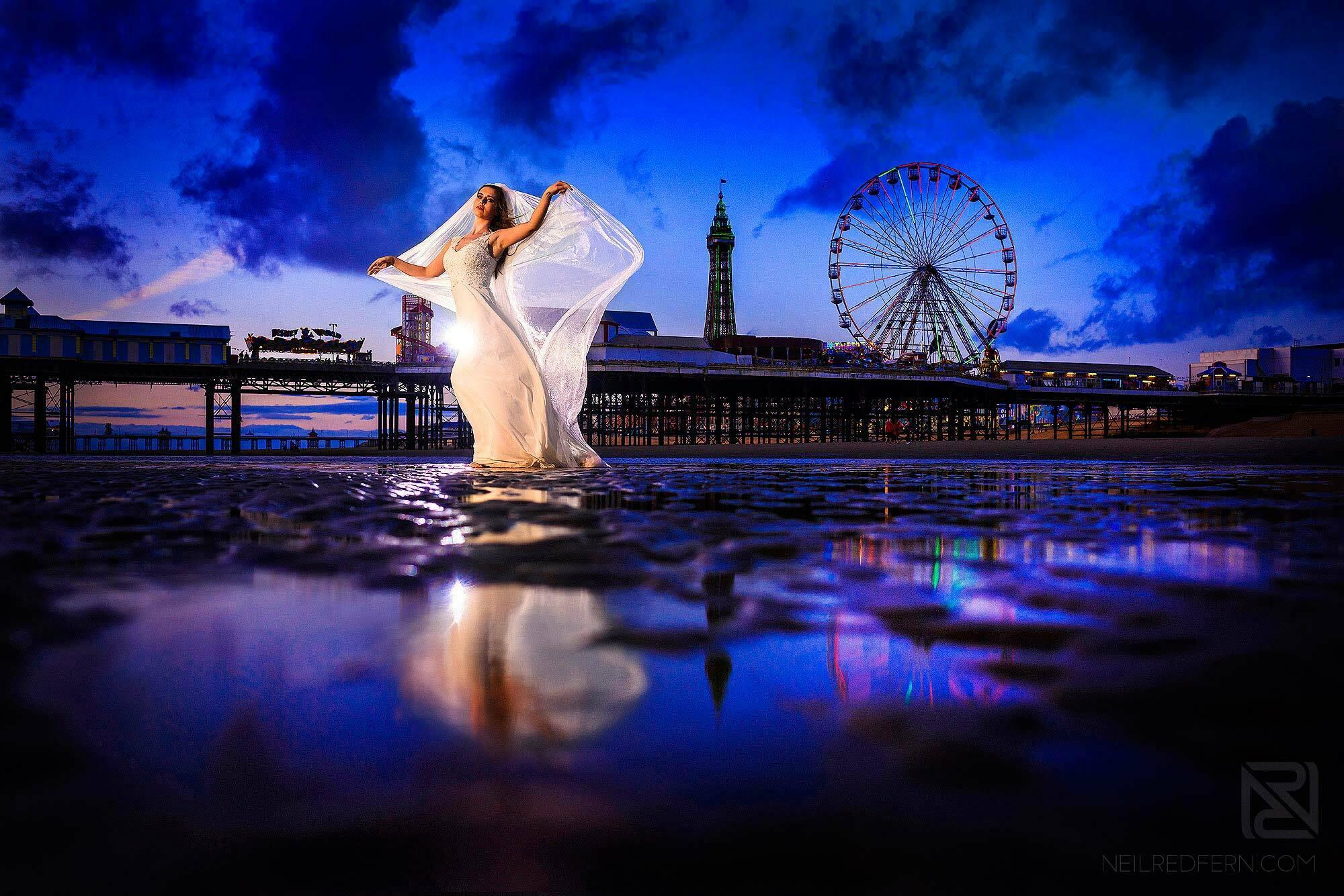creative off camera flash portrait of bride on Blackpool beach