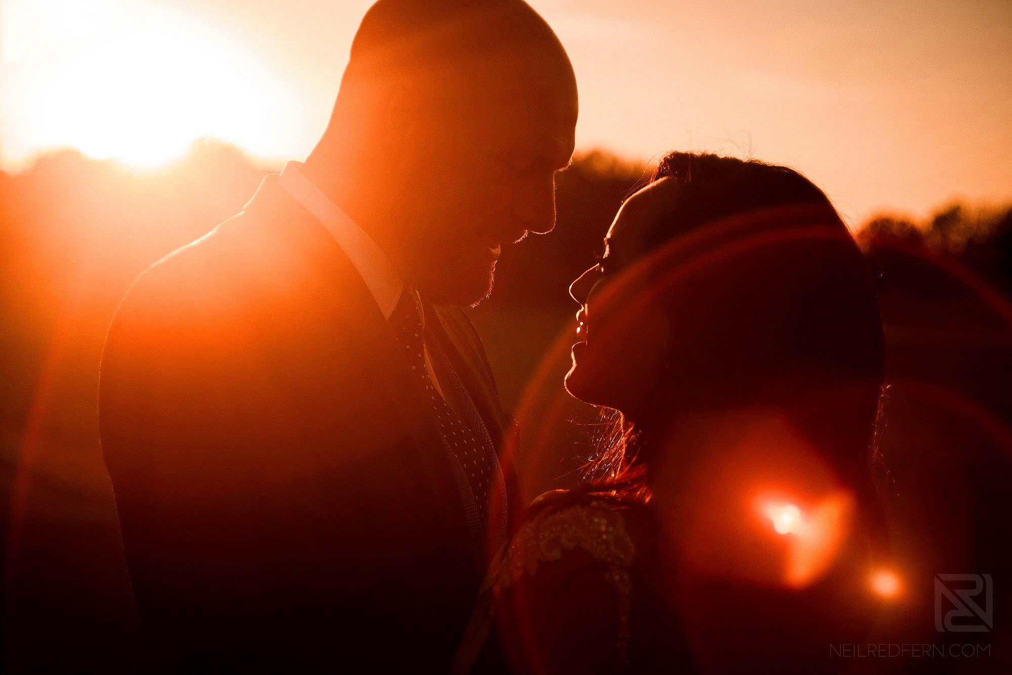 sunset portrait of newlyweds at sunset
