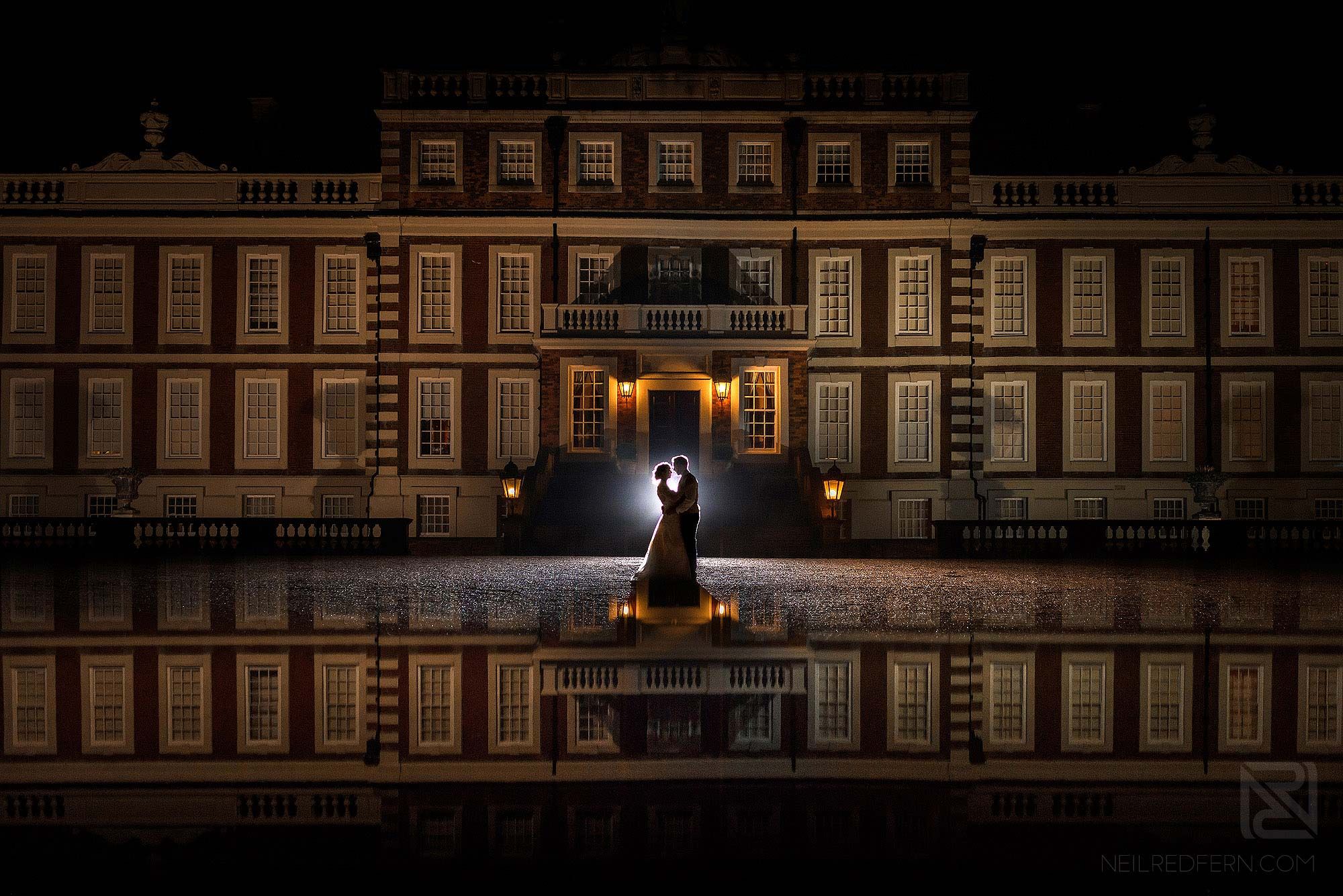 creative nighttime portrait of bride and groom at Knowsley Hall