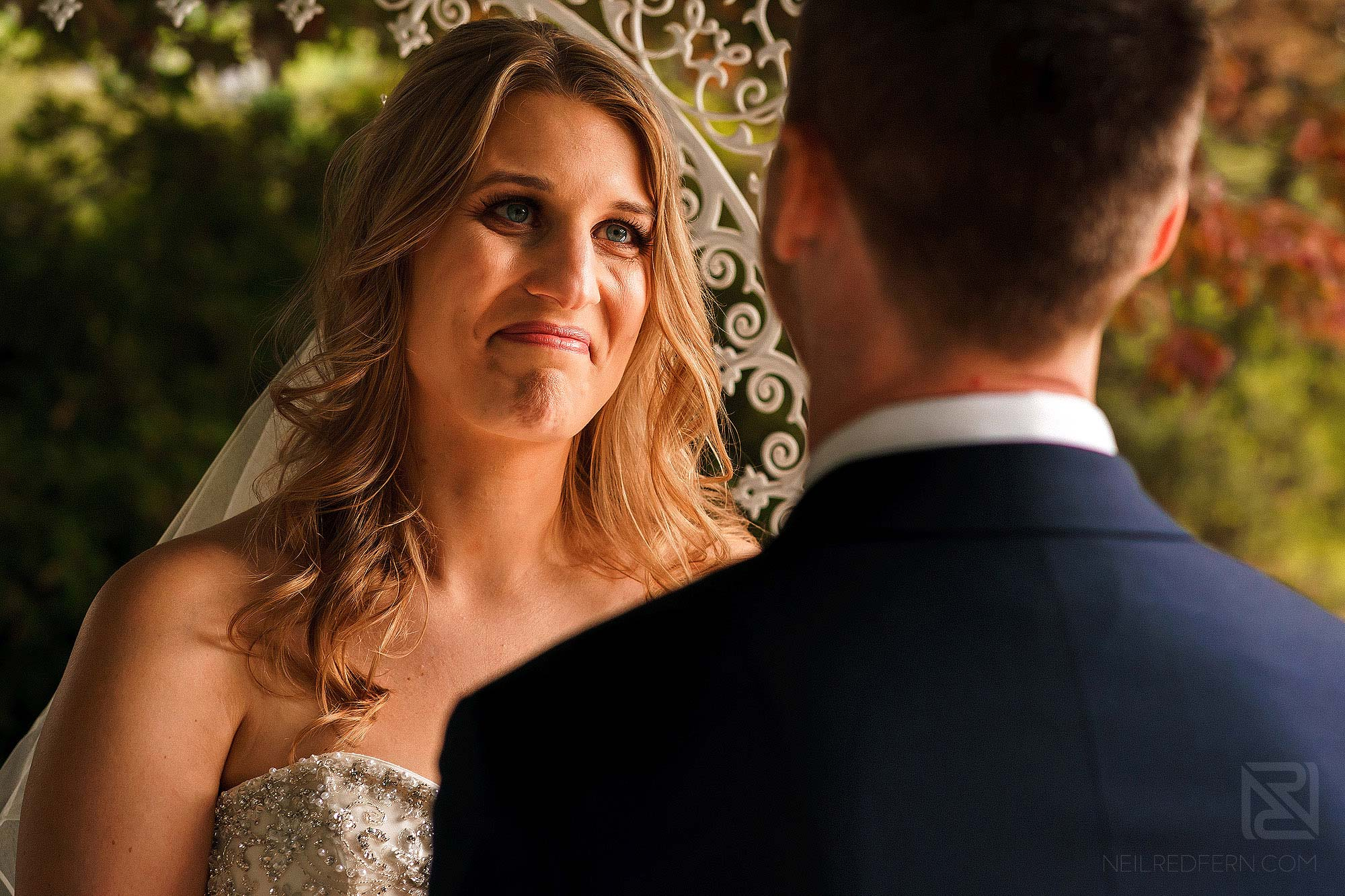 bride looking emotional during outside wedding ceremony in Lake District