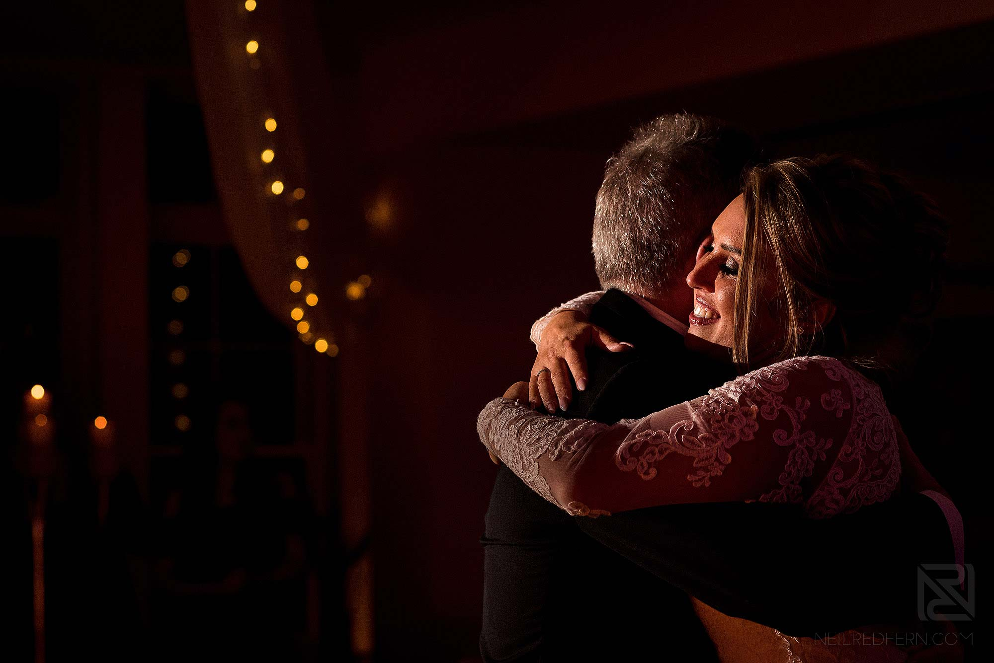 bride hugging dad on the dancefloor at wedding