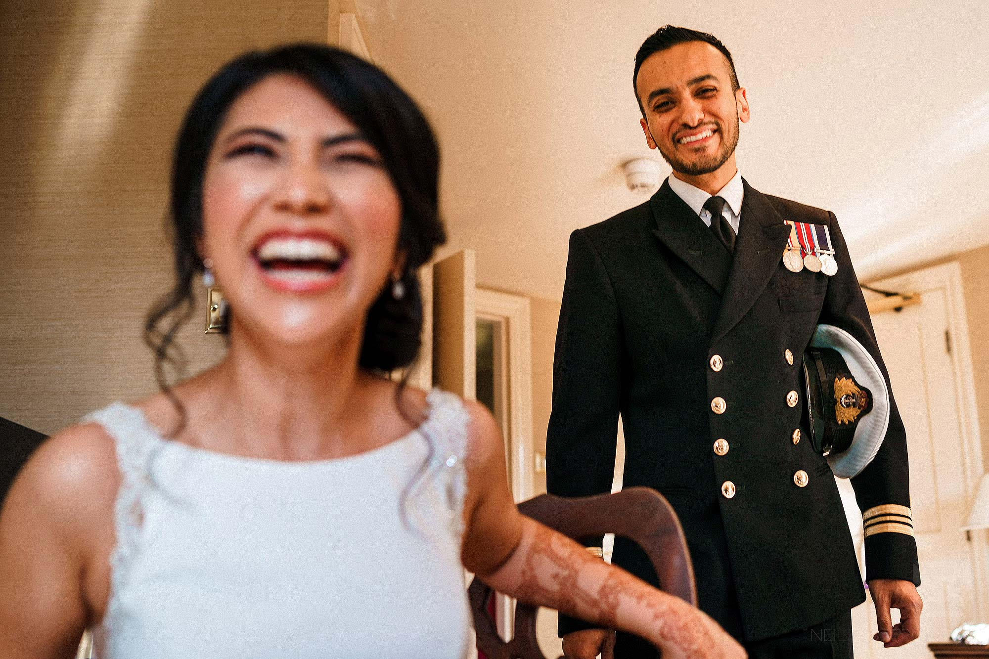 Indian bride and groom laughing