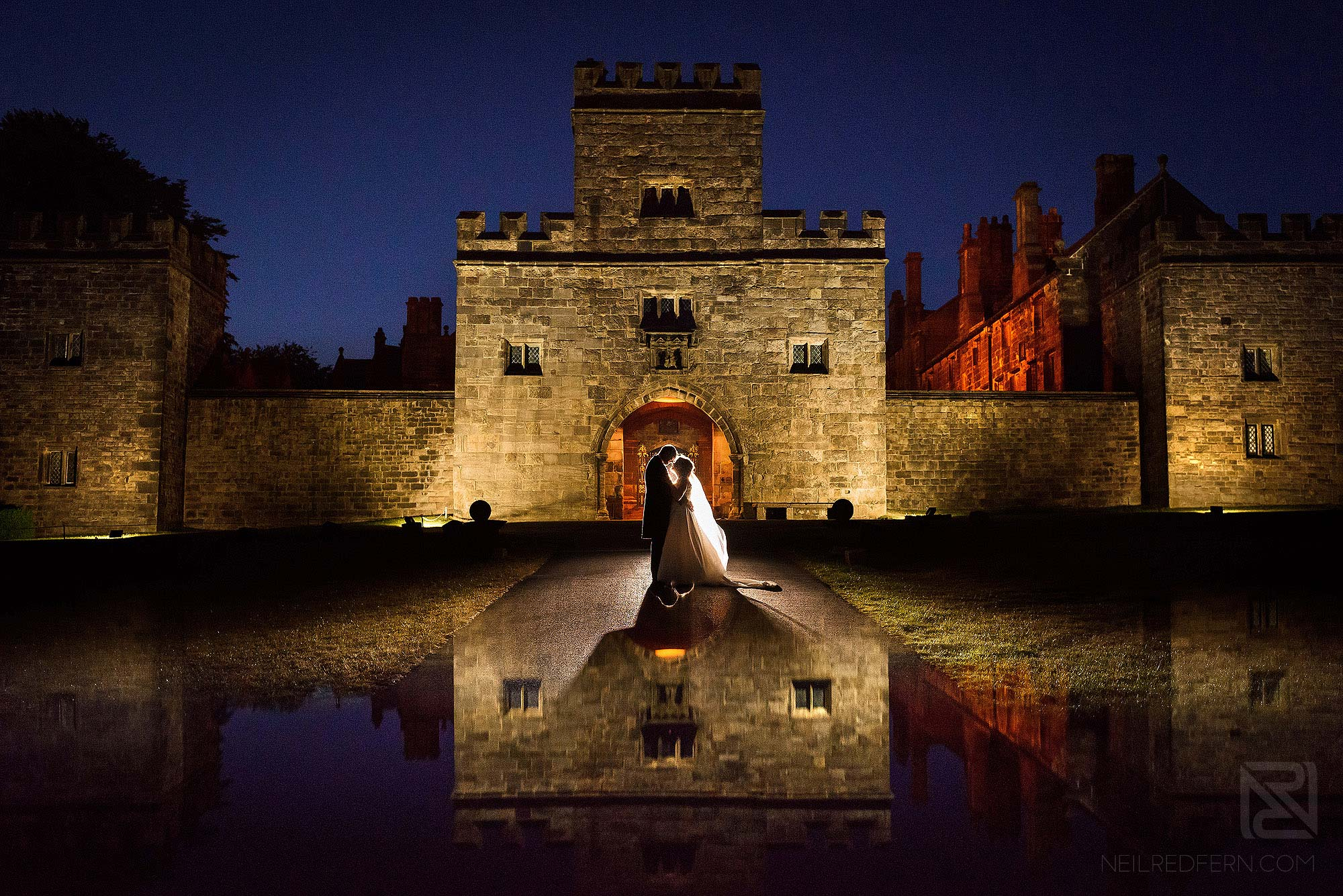 evening portrait of bride and groom outside Hoghton Tower in Lancashire