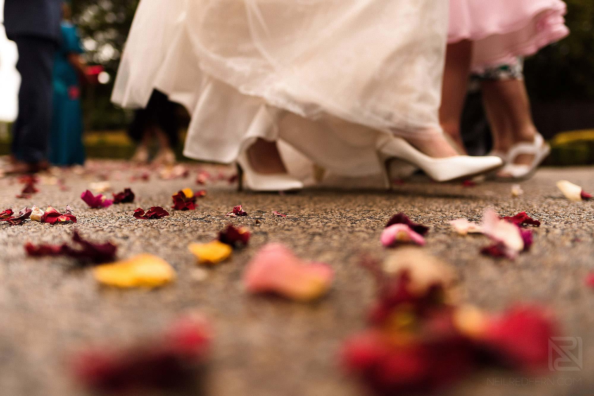 bride walking over confetti