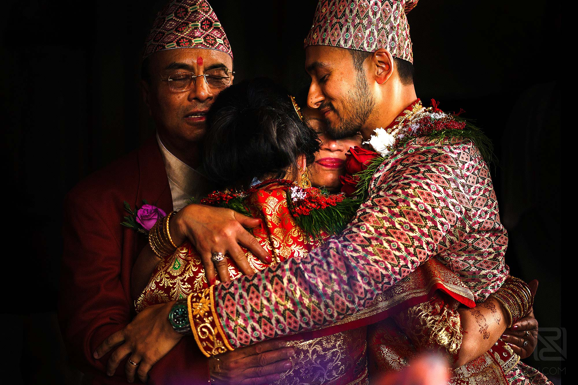 family hugging during Indian wedding ceremony