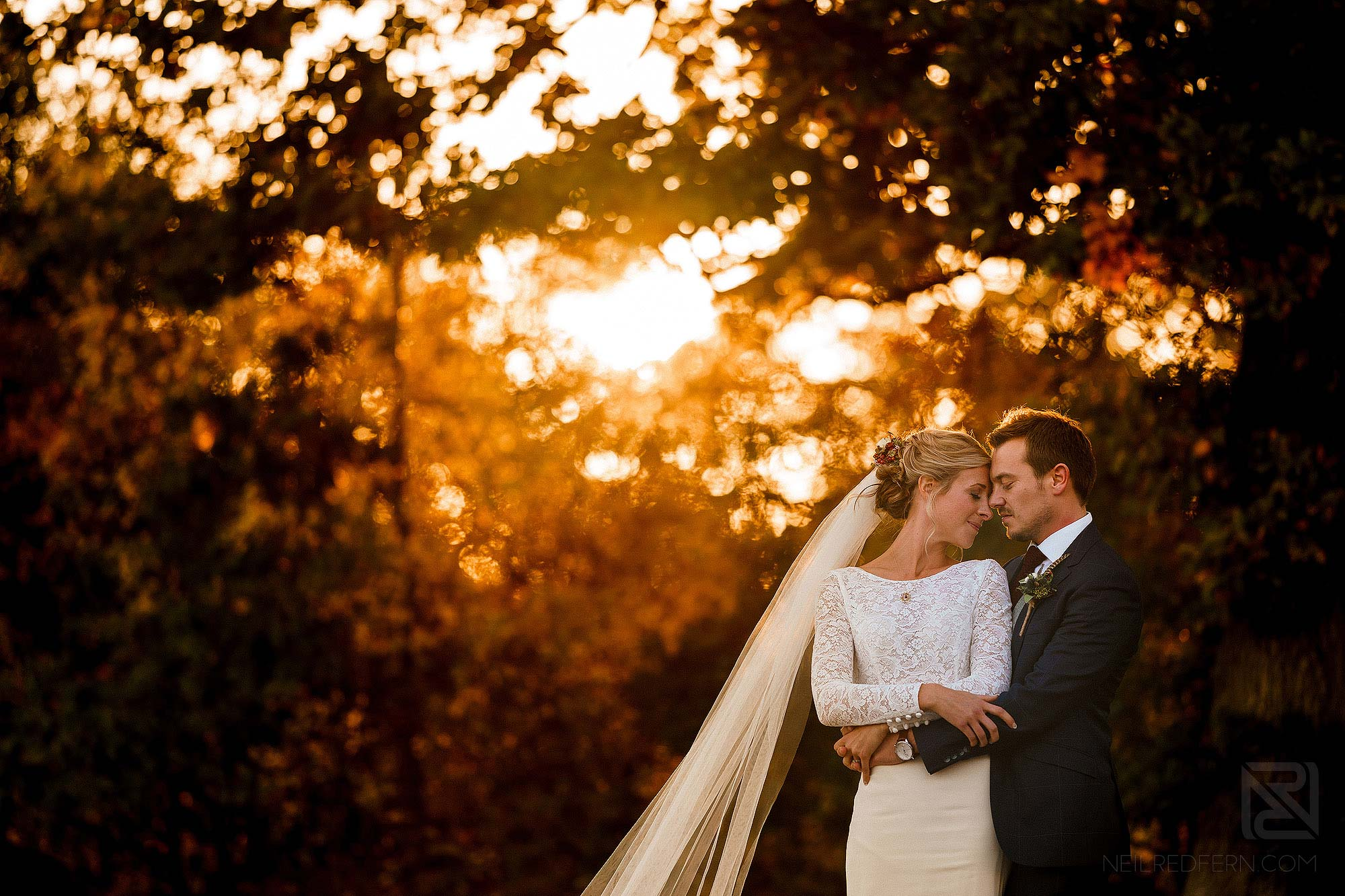 beautiful newlywed portrait of bride and groom at sunset