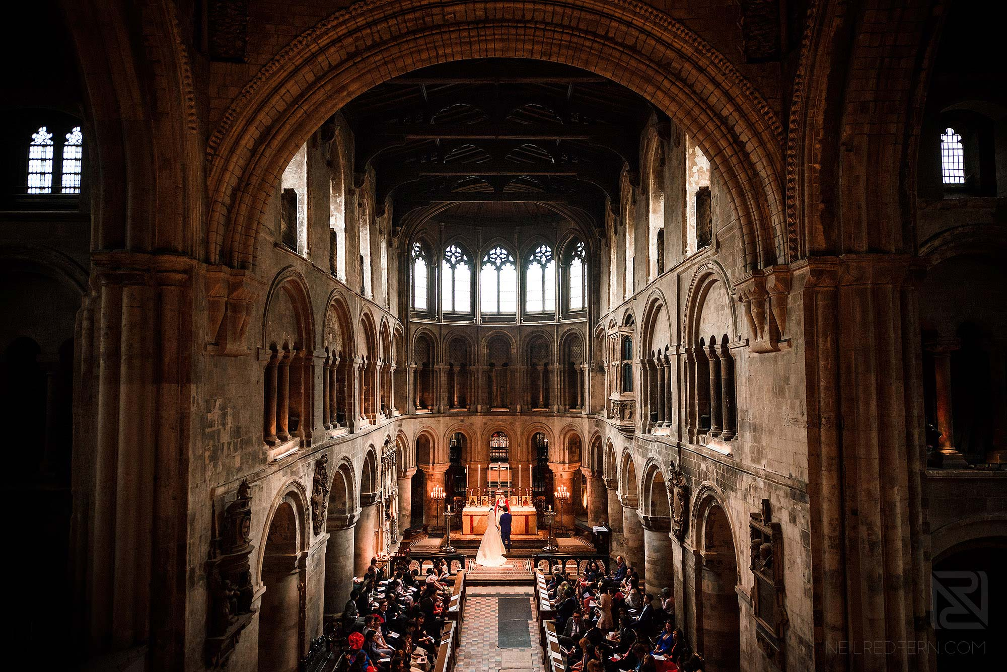 wide angle photograph of wedding ceremony at St Bartholomew-the-Great in London