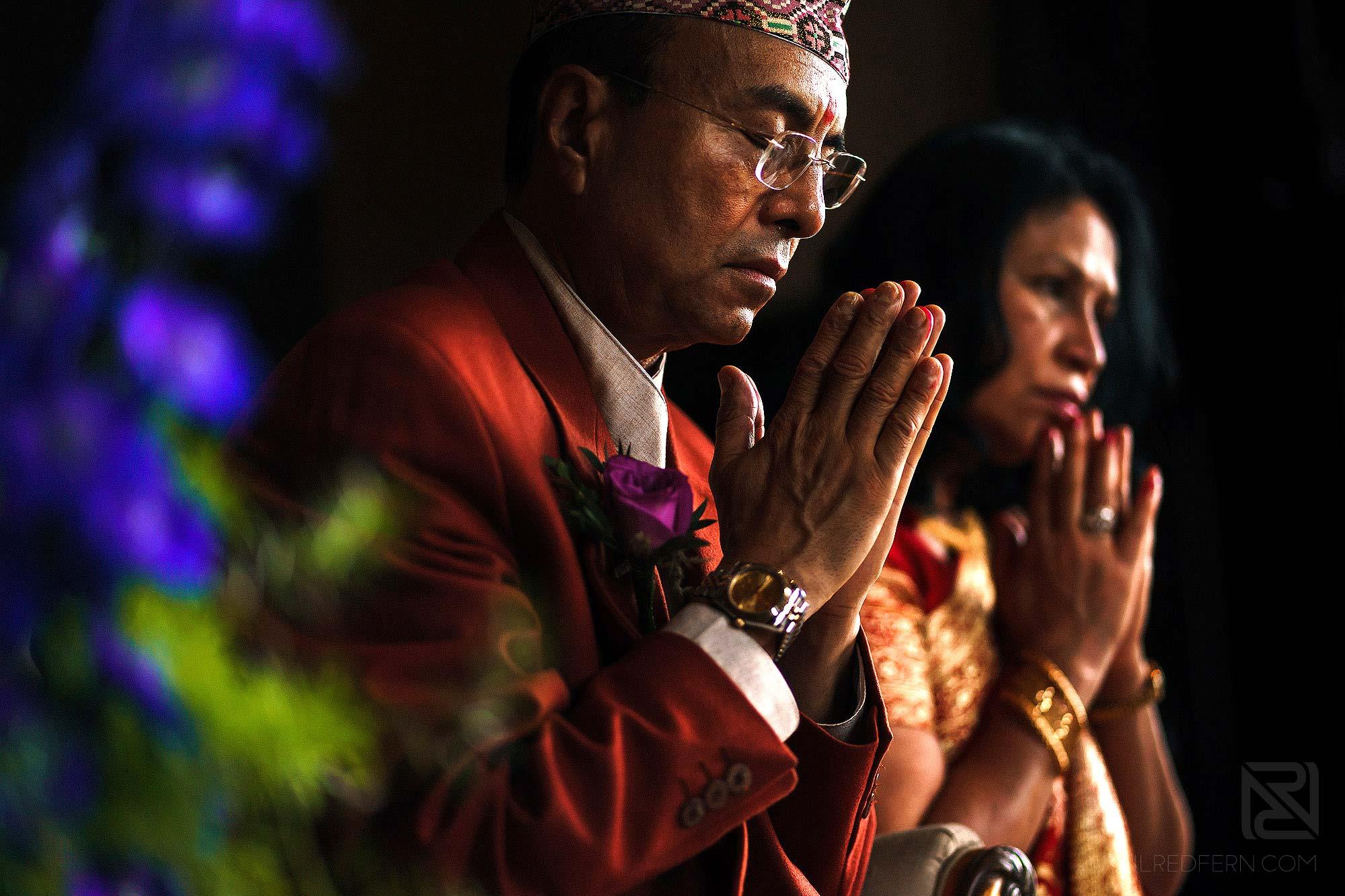 parents praying during Indian wedding ceremony