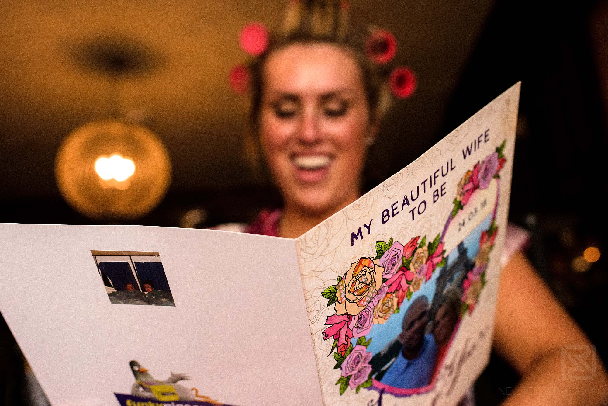 bride reading card from groom on morning of wedding