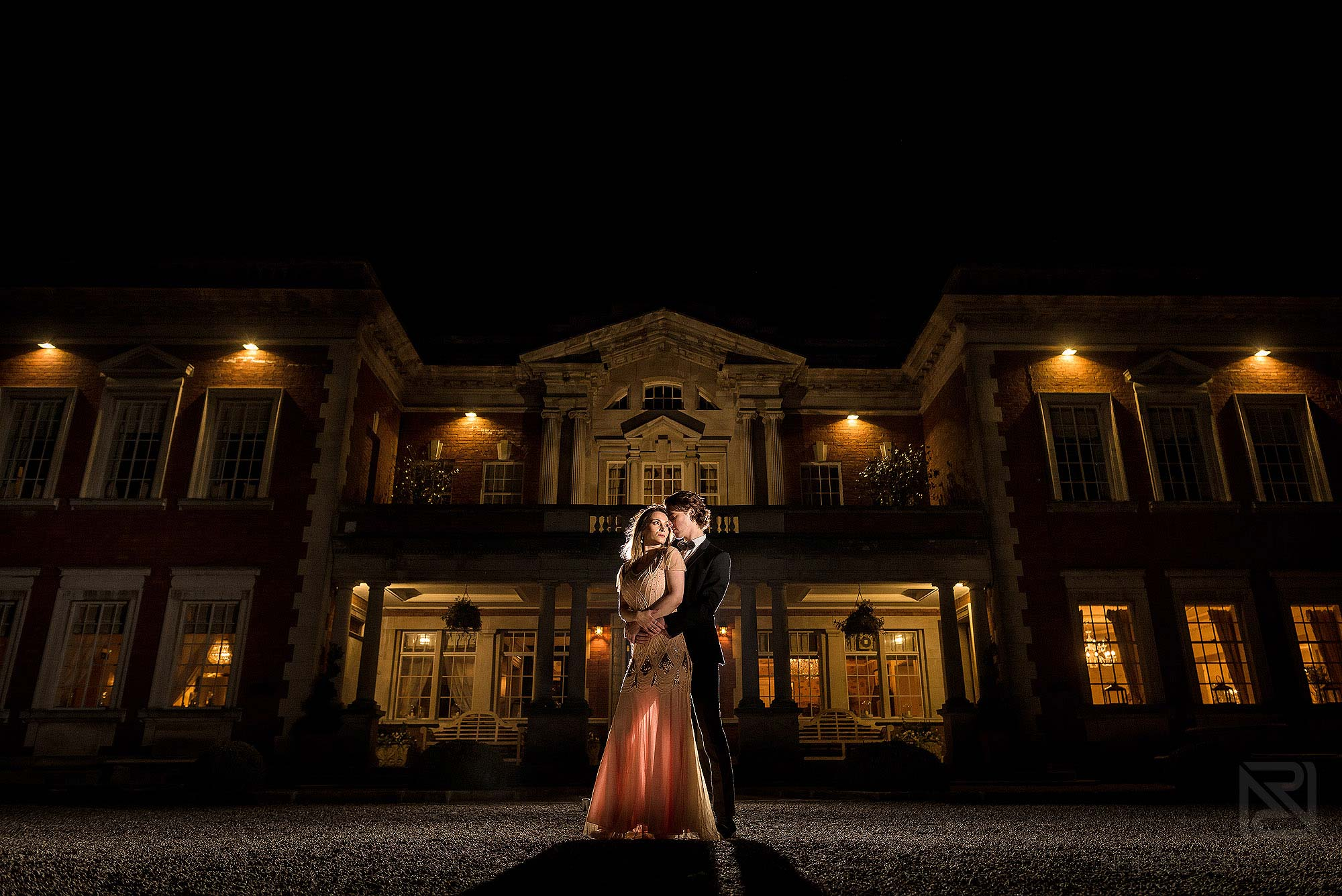 evening portrait of newly couple outside Eaves Hall in Lancashire